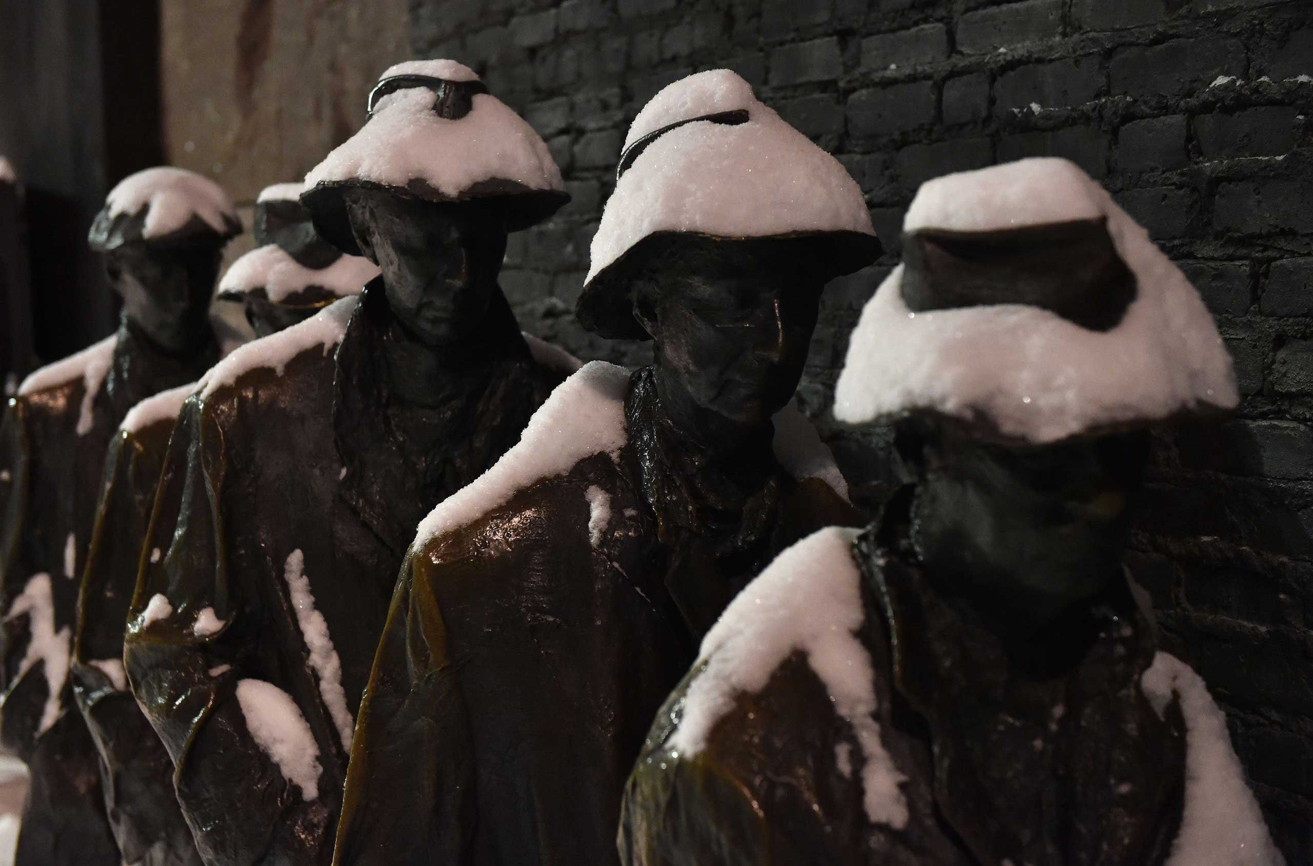 "Snow covers ""The Breadline"" sculpture at the Franklin D. Roosevelt memorial in Washington on Feb. 16, 2015."