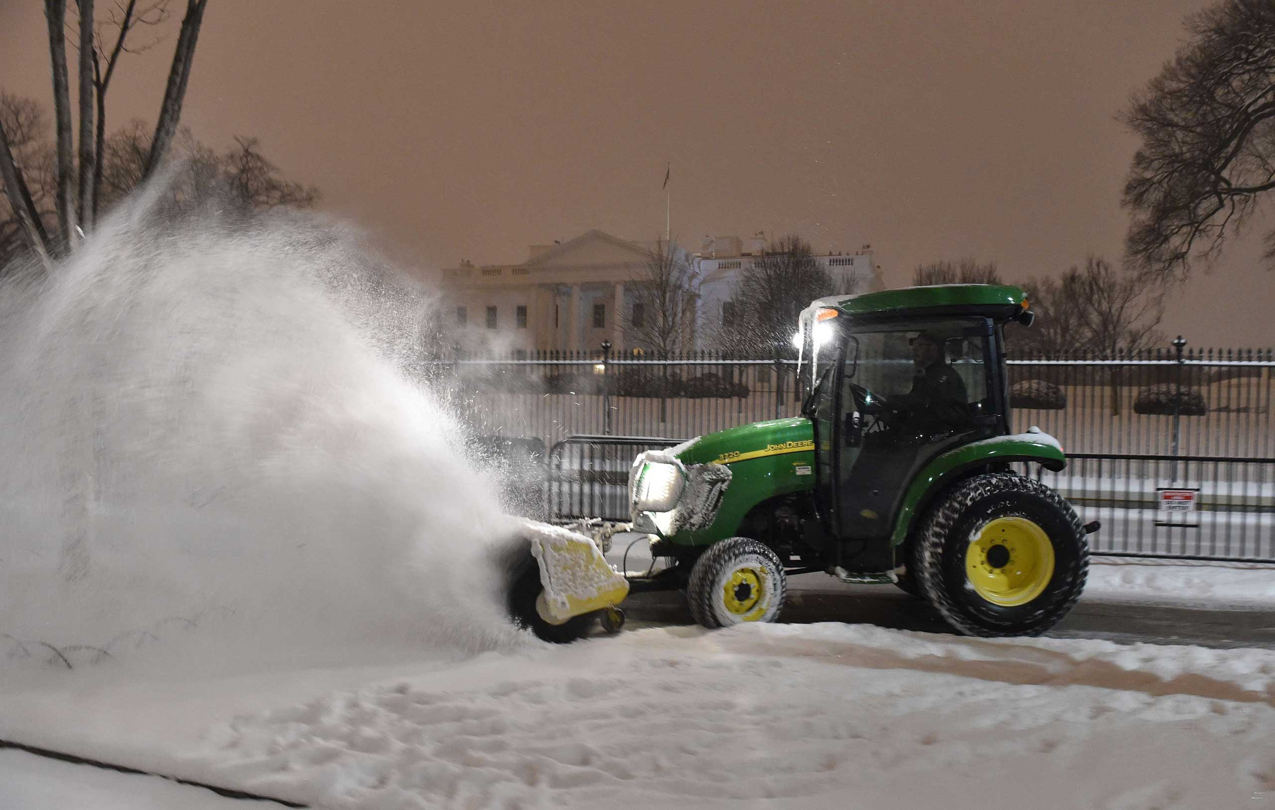 A snow-plough cleans the snow on Pennsylvania Avenue in front of the White House in Washington on Feb. 16, 2015.