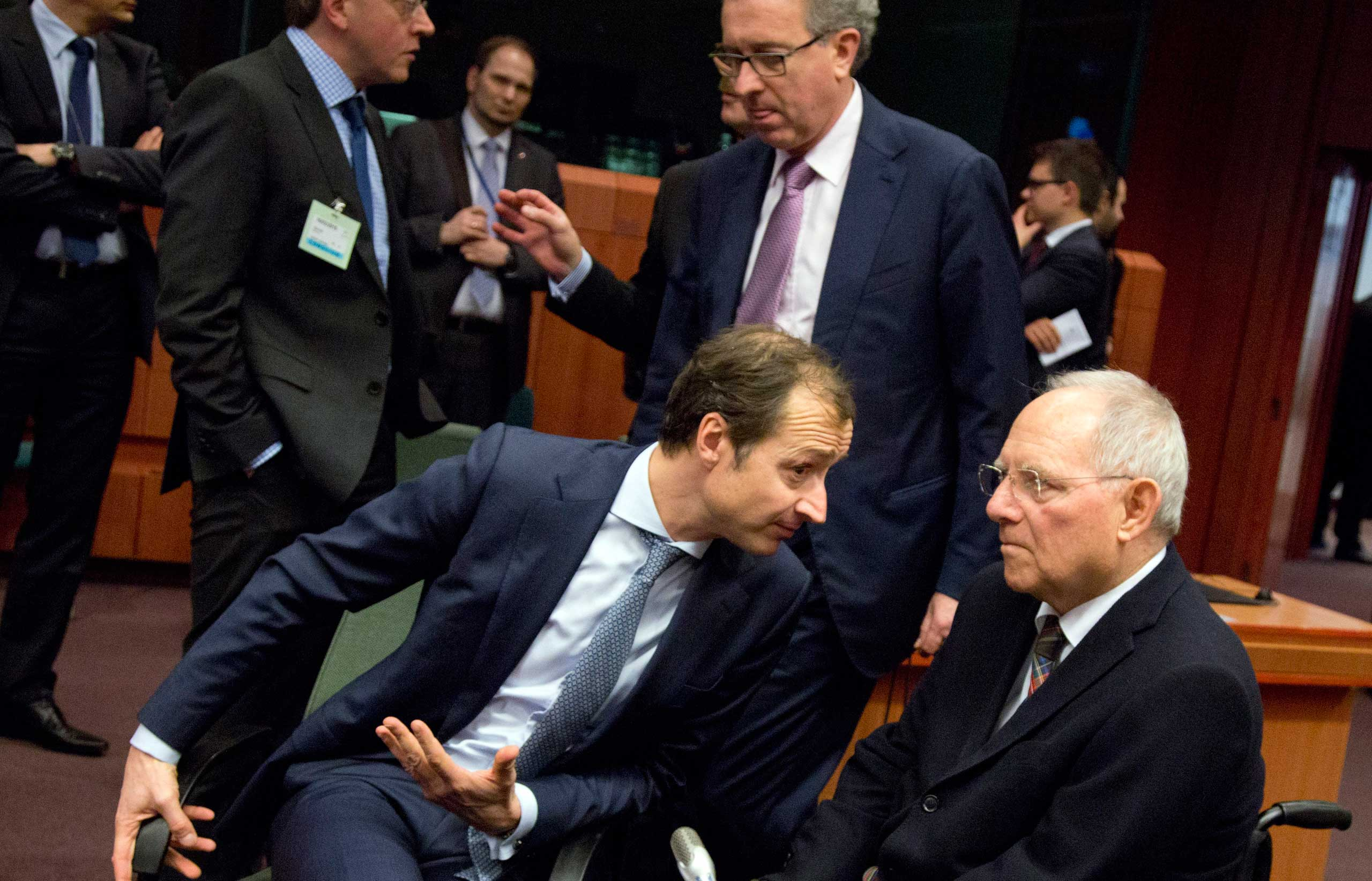 German Finance Minister Wolfgang Schaeuble, right, speaks colleagues during a meeting of Eurogroup finance ministers at the EU Council building in Brussels on Monday, Feb. 16, 2015.