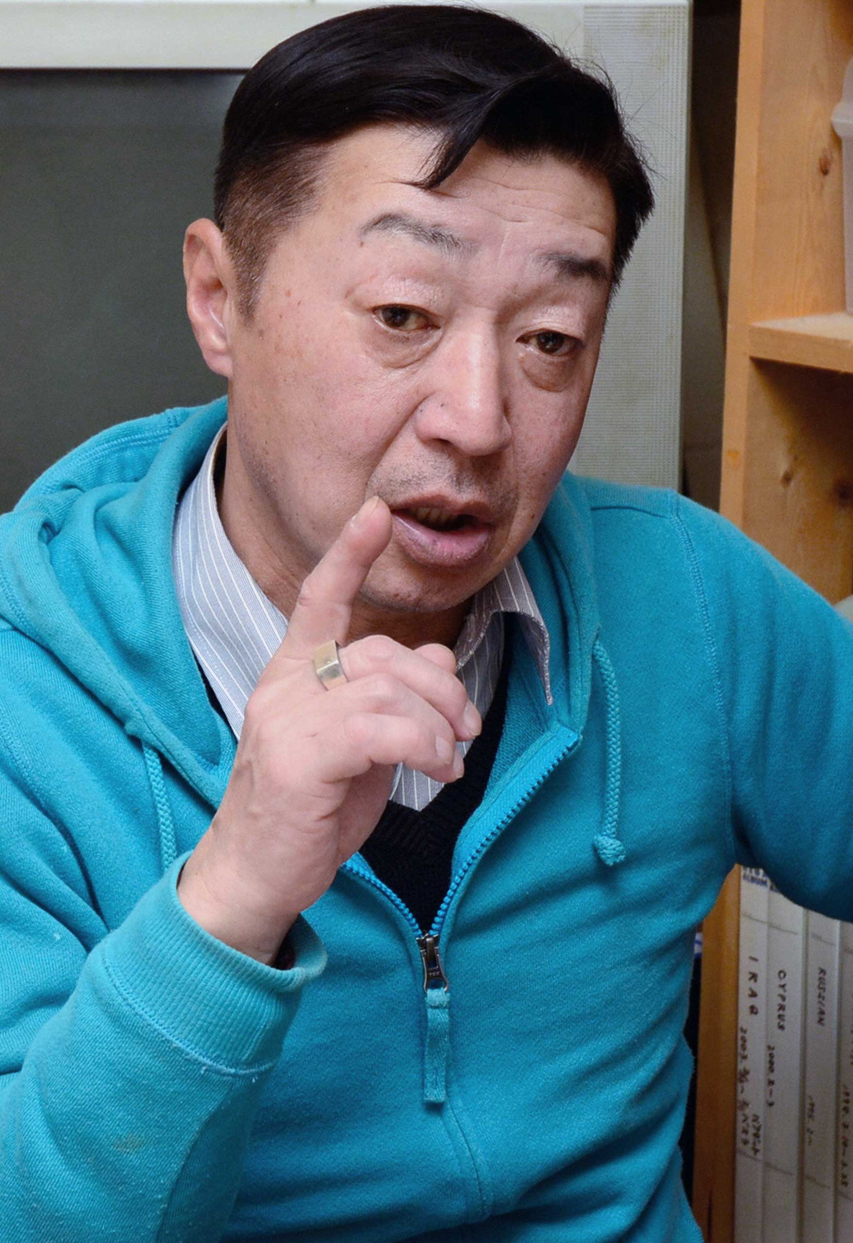 Freelance photographer Yuichi Sugimoto speaks to media reporters a day after his passport was confiscated by the Foreign Ministry at his home on Feb. 8, 2015 in Niigata, Japan.