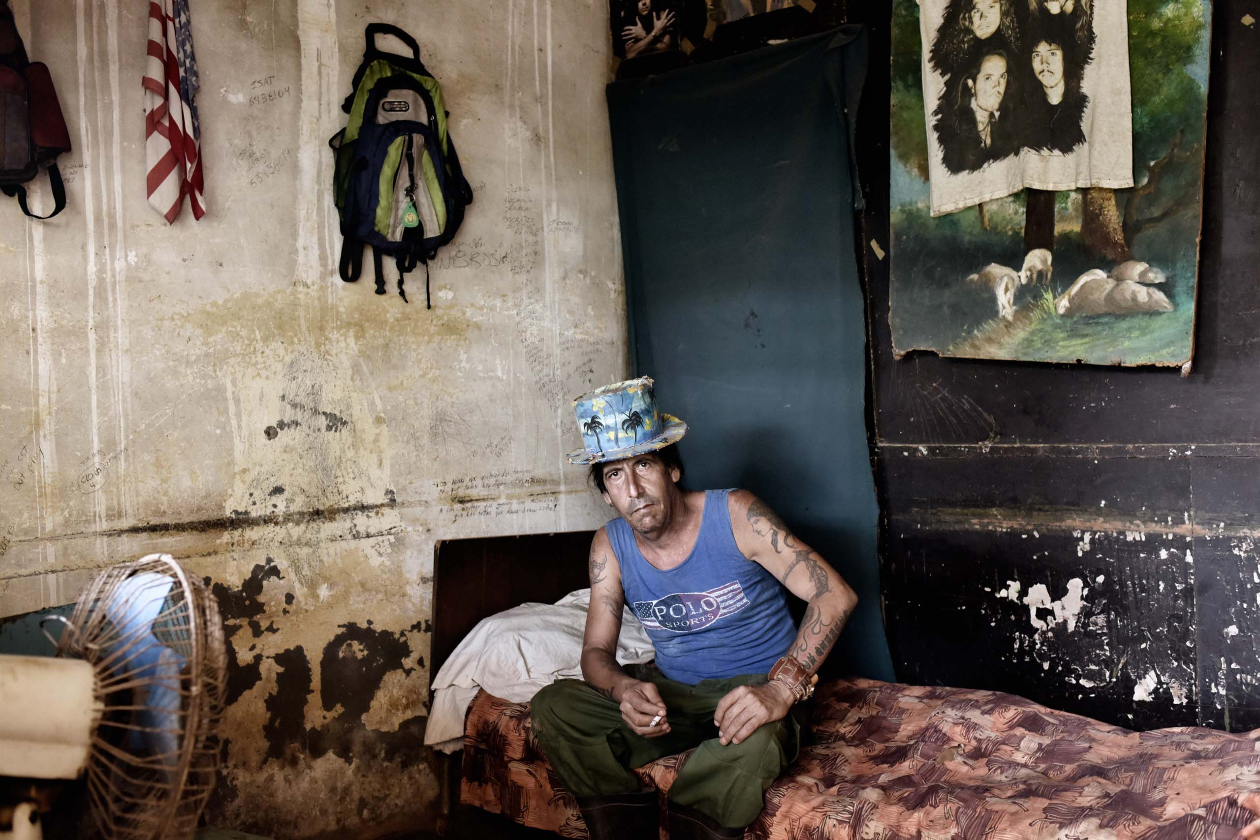 "January 2015. A former drummer for the popular Cuban rock band ""Qva Libre"" sits in his home in Guira de Melena, Cuba."