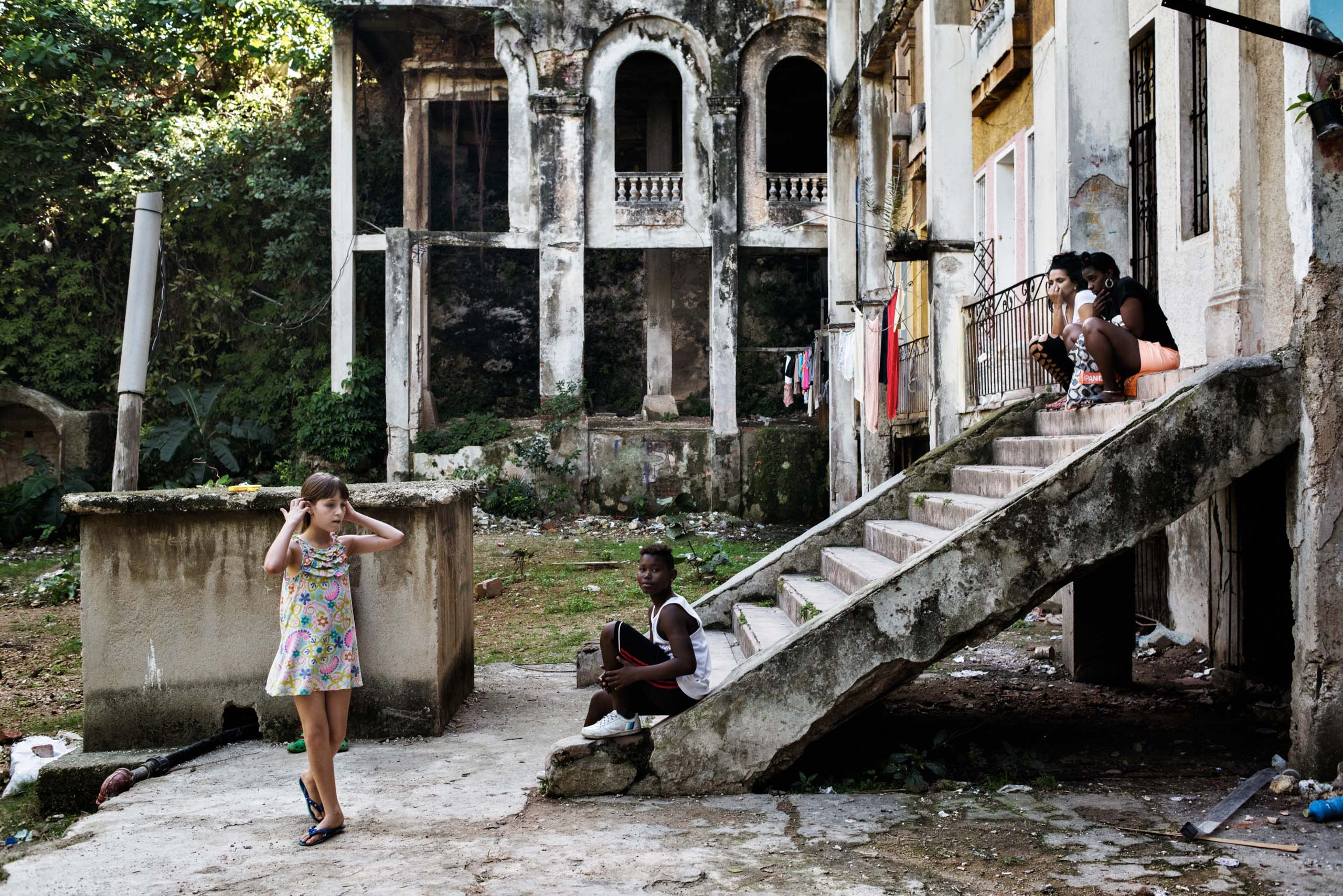 December 2015. Young girls play on the grounds of the Arcos building, an iconic building in the El Vedado neighborhood of Havana.