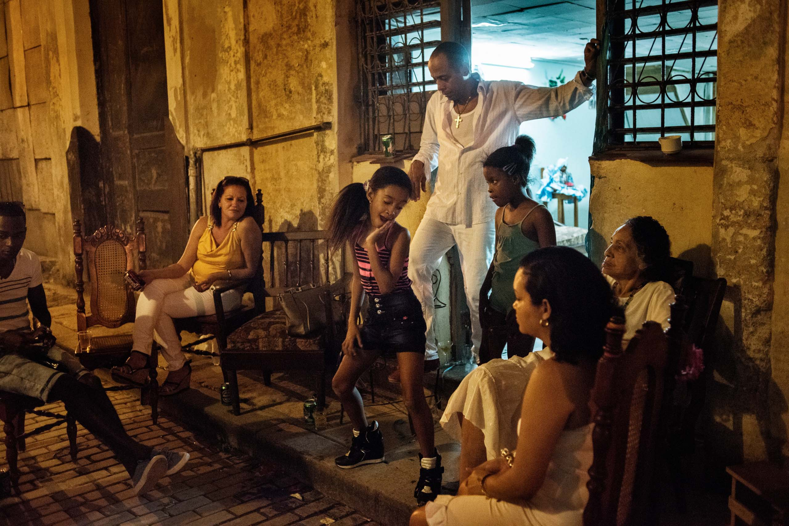 January 2015. A family gathers outside of their home in Havana, Cuba.