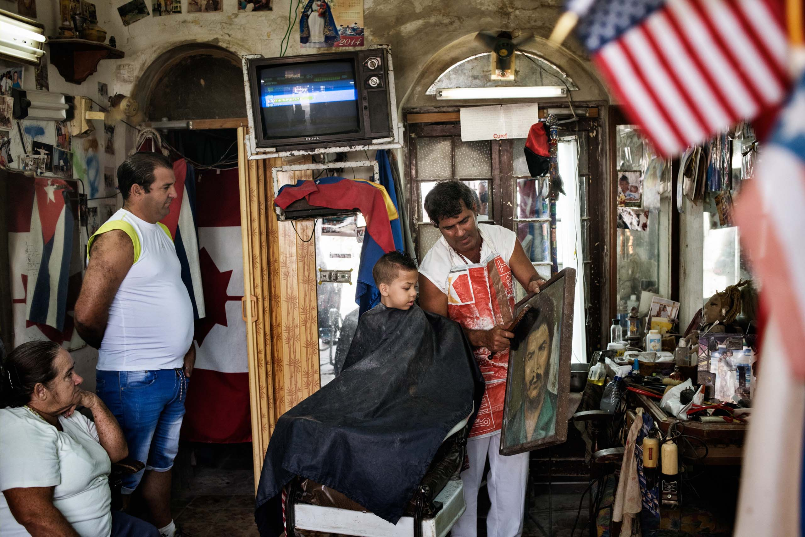 December 2014. A little boy gets his haircut in a barbershop in Regla, a suburb of Havana.