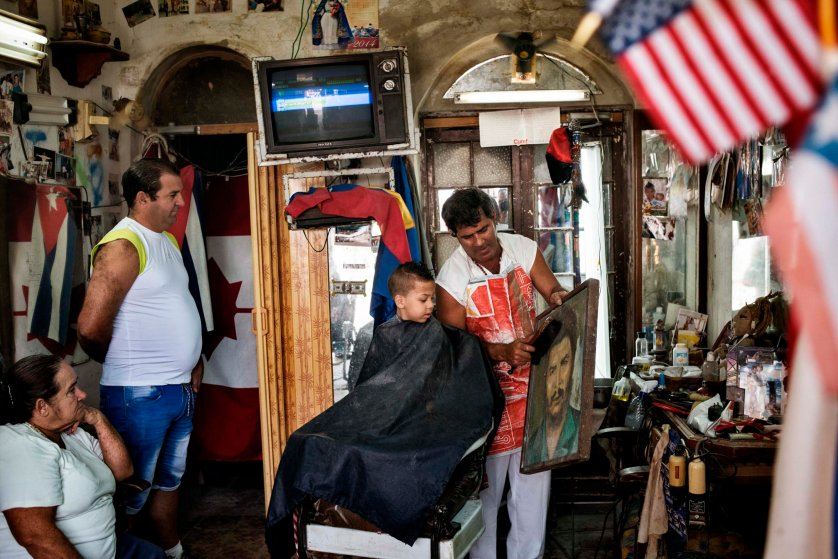 December 2014. A little boy gets his haircut in a barbershop in Regla, a suburb of Havana.