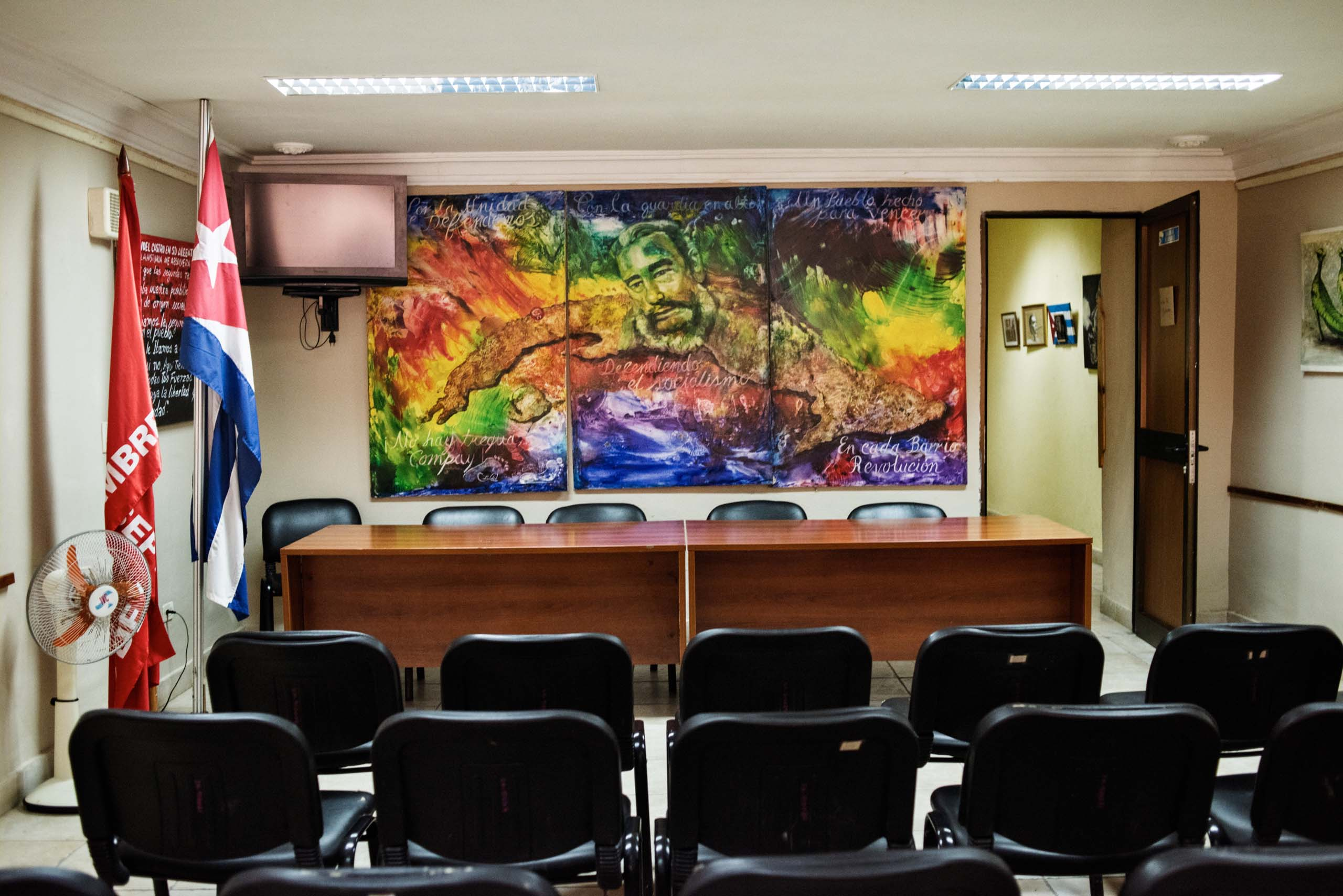 "December 2014. A theater and conference room inside the headquarters of the  Committees for the Defense of the Revolution. The CDR  was established in 1960 as the so-called ""eyes and ears of the revolution."" In all parts of the country, neighborhood watch groups act as an information network for the police."