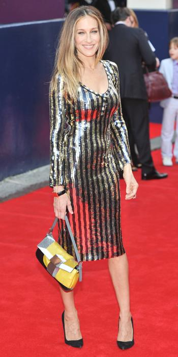 MARC JACOBS, 2013                                At the Charlie and the Chocolate Factory press night at Theatre Royal in London, Parker lit up the red carpet in a black and gold stripe sequined Marc Jacobs dress that she paired with a Fendi baguette and black pointy-toe pumps.