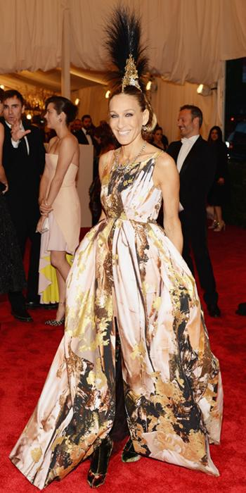 GILES, 2013                                At the Metropolitan Museum of Art's annual gala, the actress fully embodied the punk theme in a gold, paint-splattered Giles gown, that she paired with a custom Philip Treacy mohawk headpiece.