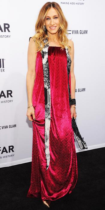 MAISON MARTIN MARGIELA, 2013                                Parker paraded out a bold style statement at the amfAR New York Gala in this fuchsia silk velvet column gown and sash by Maison Martin Margiela.