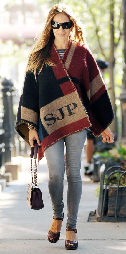 BURBERRY, 2014                                Parker was one of the first celebs to rock Burberry's hot-off-the-runway monogrammed blanket poncho.