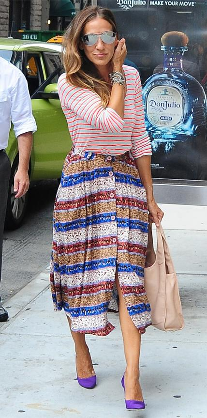 STRIPED SHIRT AND SKIRT, 2014                                Proving her street style status, SJP was snapped out in N.Y.C. in a red-and-white striped top that she expertly paired with a full-buttoned chunky striped midi-length skirt.
