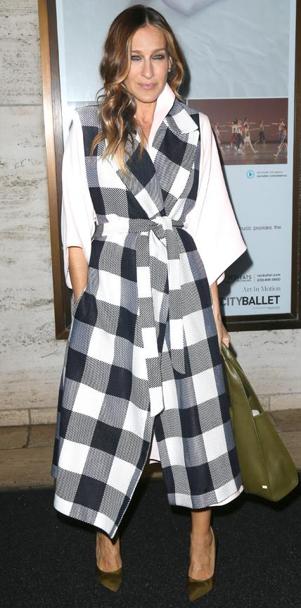 GINGHAM COAT, 2015                                The star upped her style game with a sleeveless coat in gingham, accessorizing her look with an olive bag and heels.