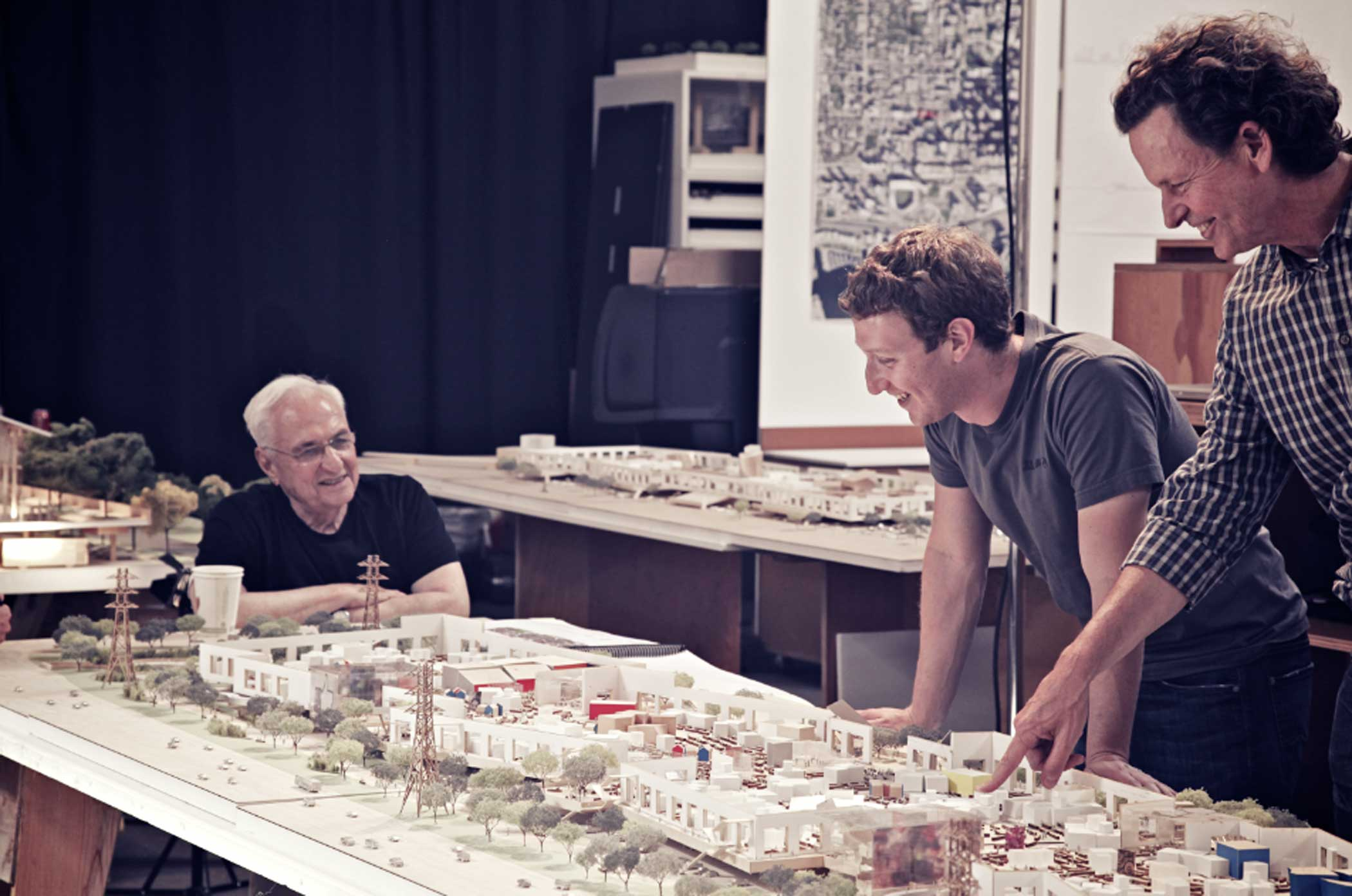 Architect Frank Gehry and Mark Zuckerberg review the model before it's construction.