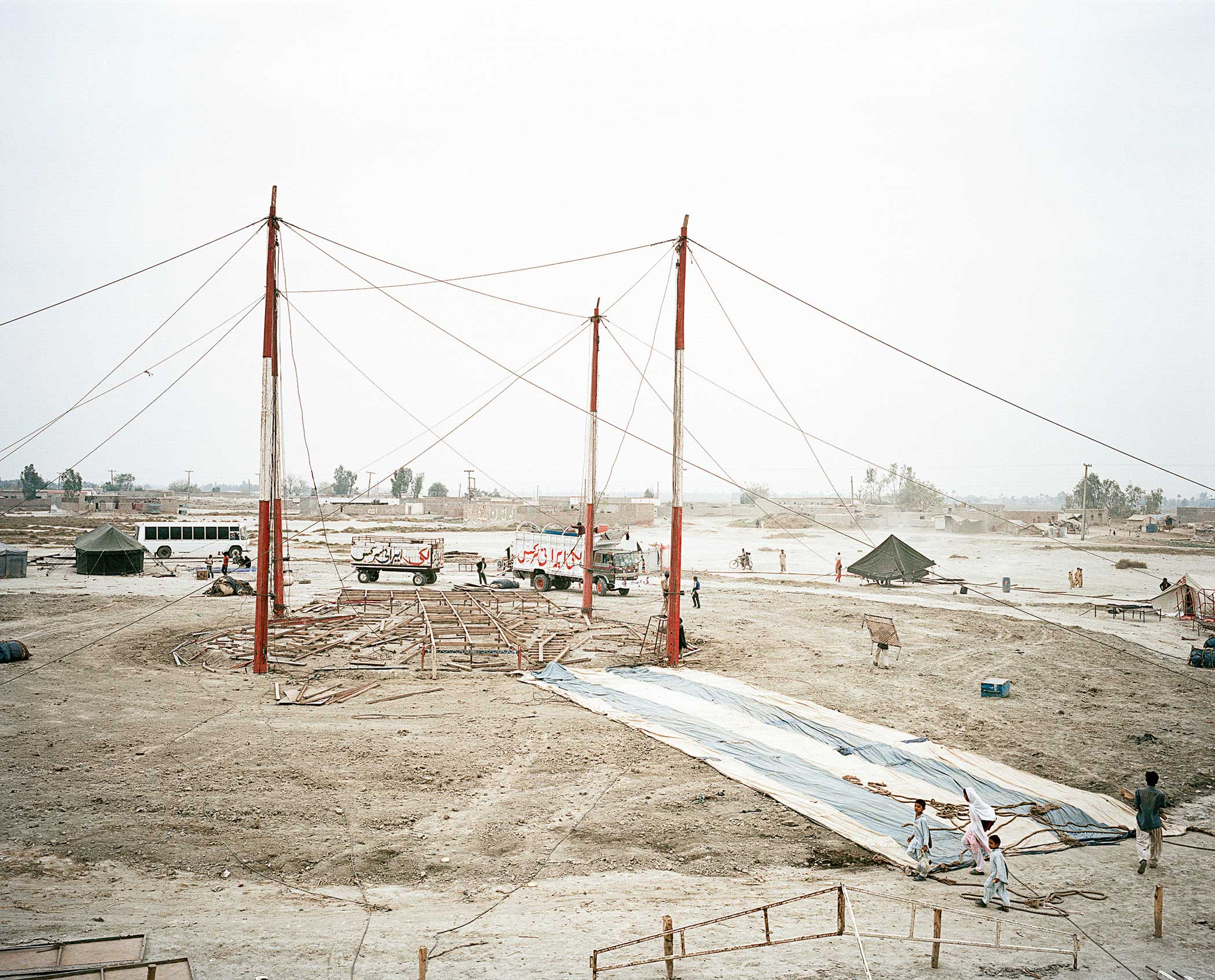 Lucky Irani Circus                               The tent begins to be setup in South Punjab, Pakistan.