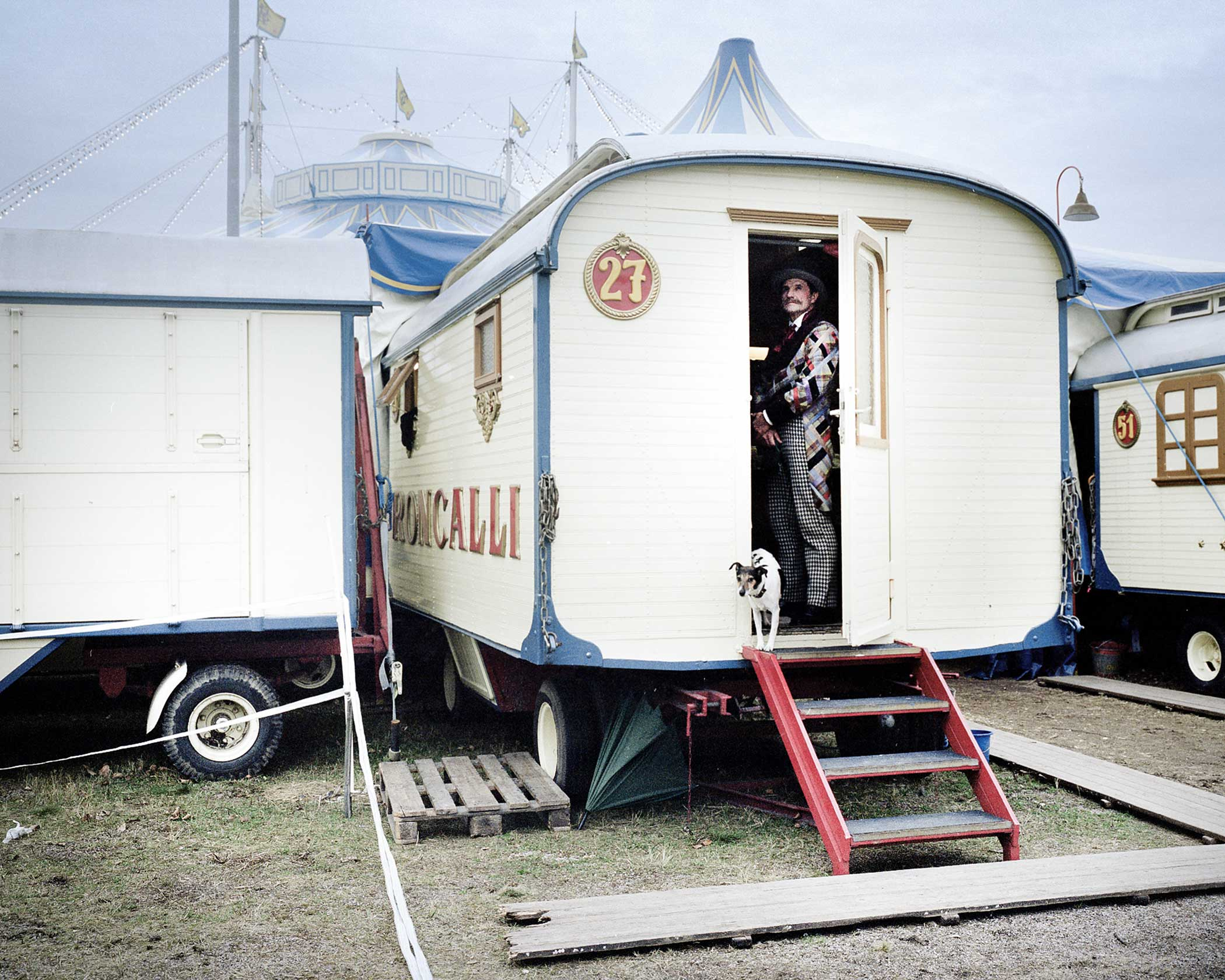 Circus Roncalli                               Dog trainer Leonid Beljakov with one of his dogs in front of his caravan.