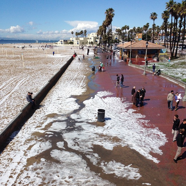 Ed Templeton captured this snapshot at the Huntingon Beach pier, writing,  the alluvial fan of melting hailstones fascinates passers by at the #huntingtonbeach pier.