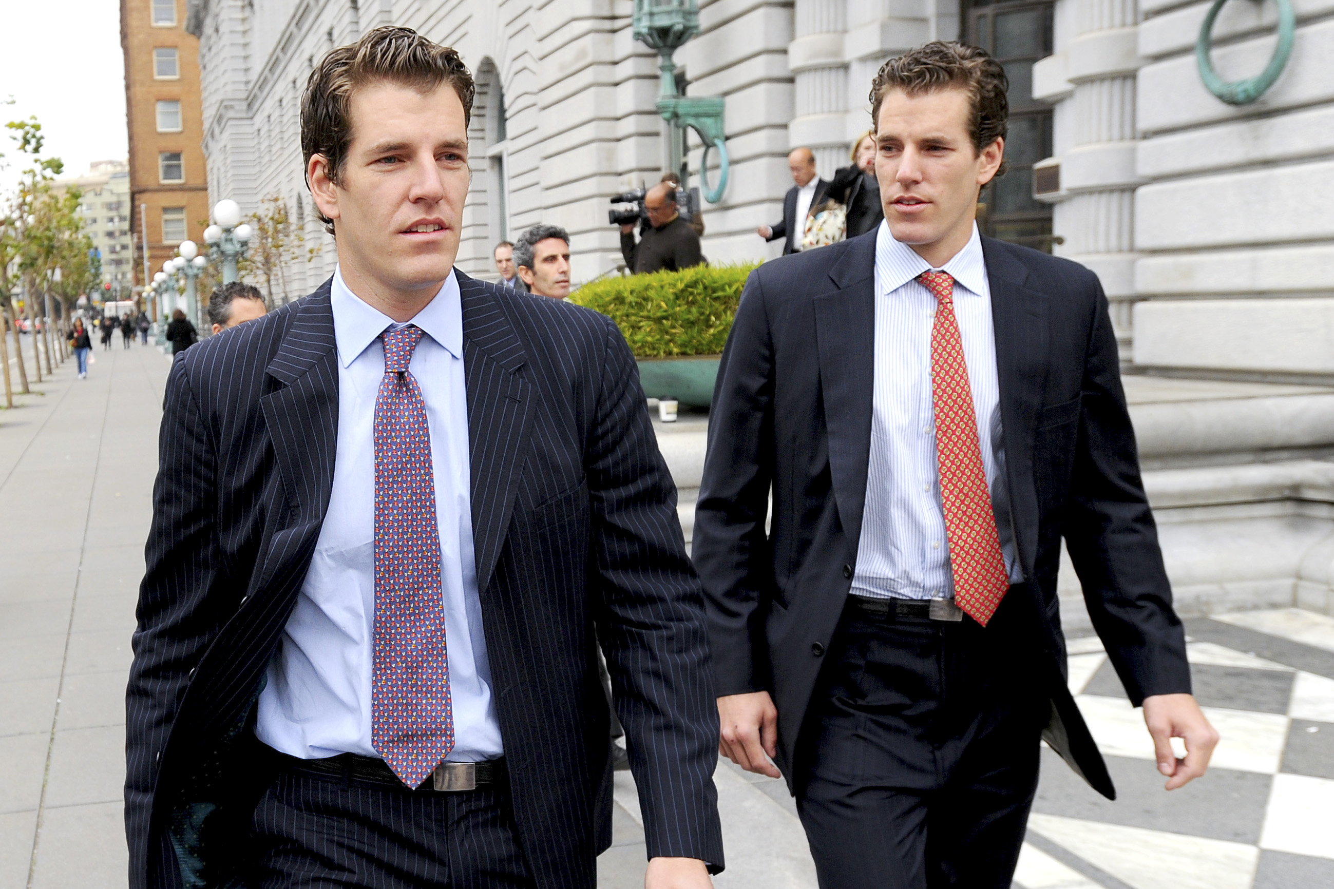 Cameron Winklevoss, right, and his twin brother Tyler leave a federal appeals court in San Francisco, California, U.S., on Tuesday, Jan. 11, 2011.