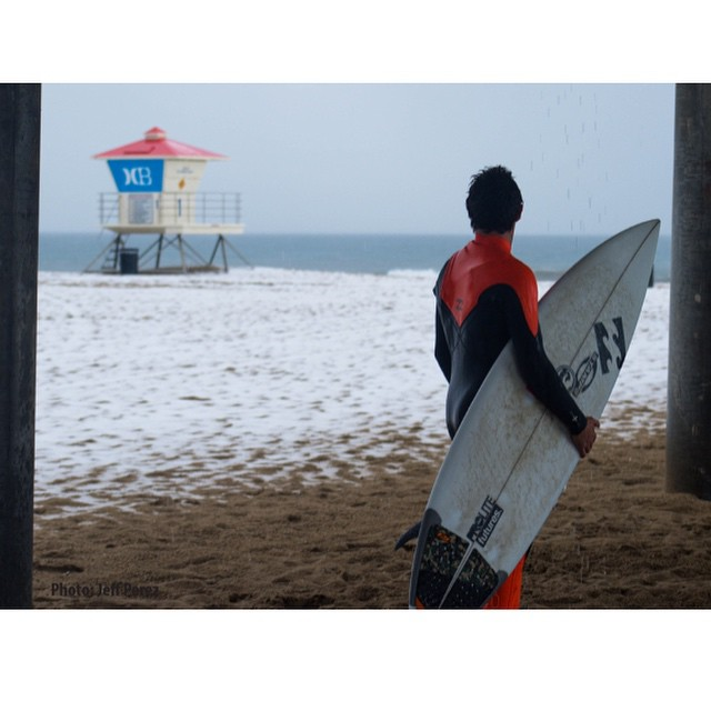 Jeff Perez captured this surfer, adding,  Out here appreciating somethin HB hasn't seen in many years, snow.