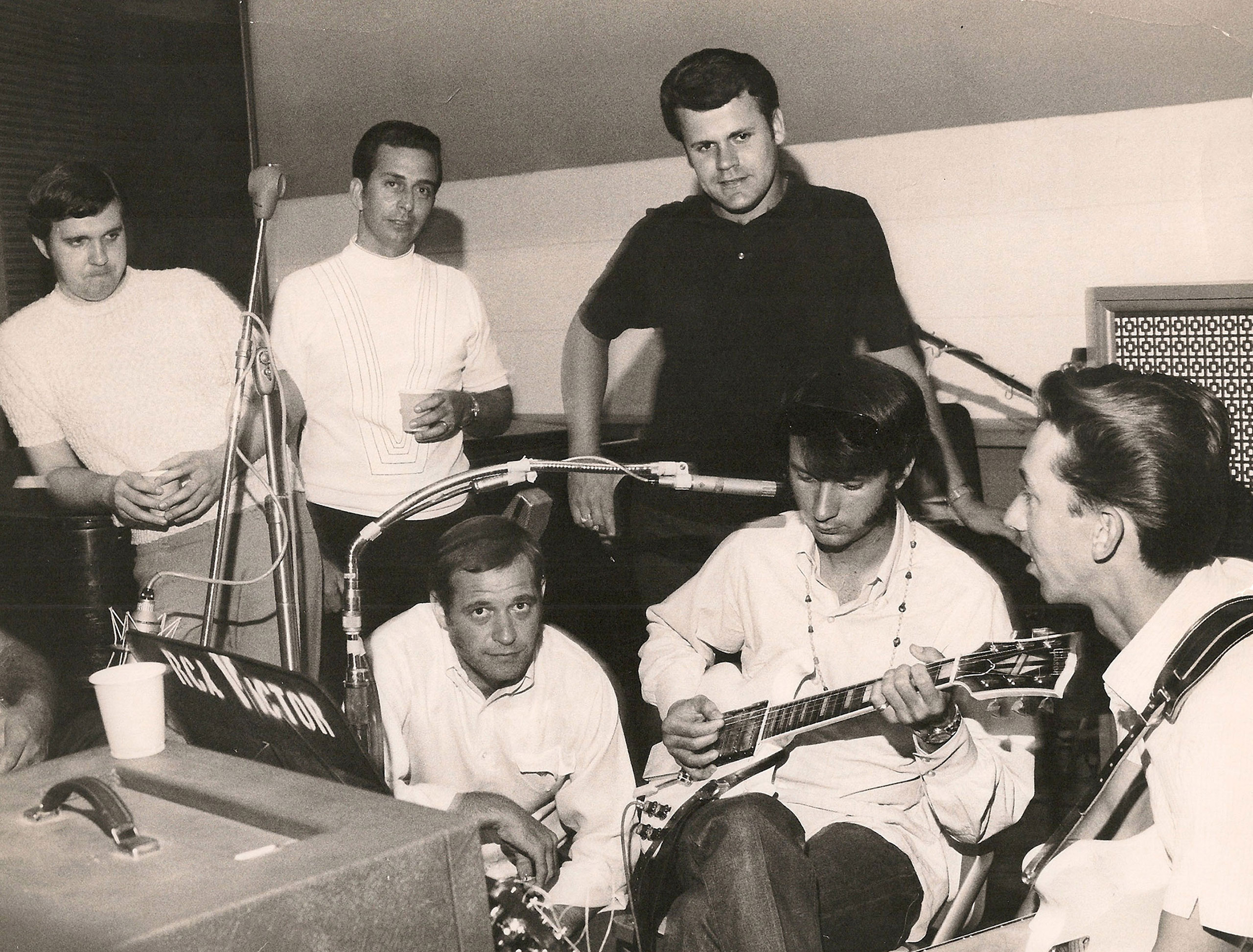 Pictured recording in RCA Studio A are (standing, l-r): Norbert Putnam, Lloyd Green, and Kenny Buttrey; (seated, l-r): Felton Jarvis, The Monkees' Michael Nesmith, and Wayne Moss, 1960s.