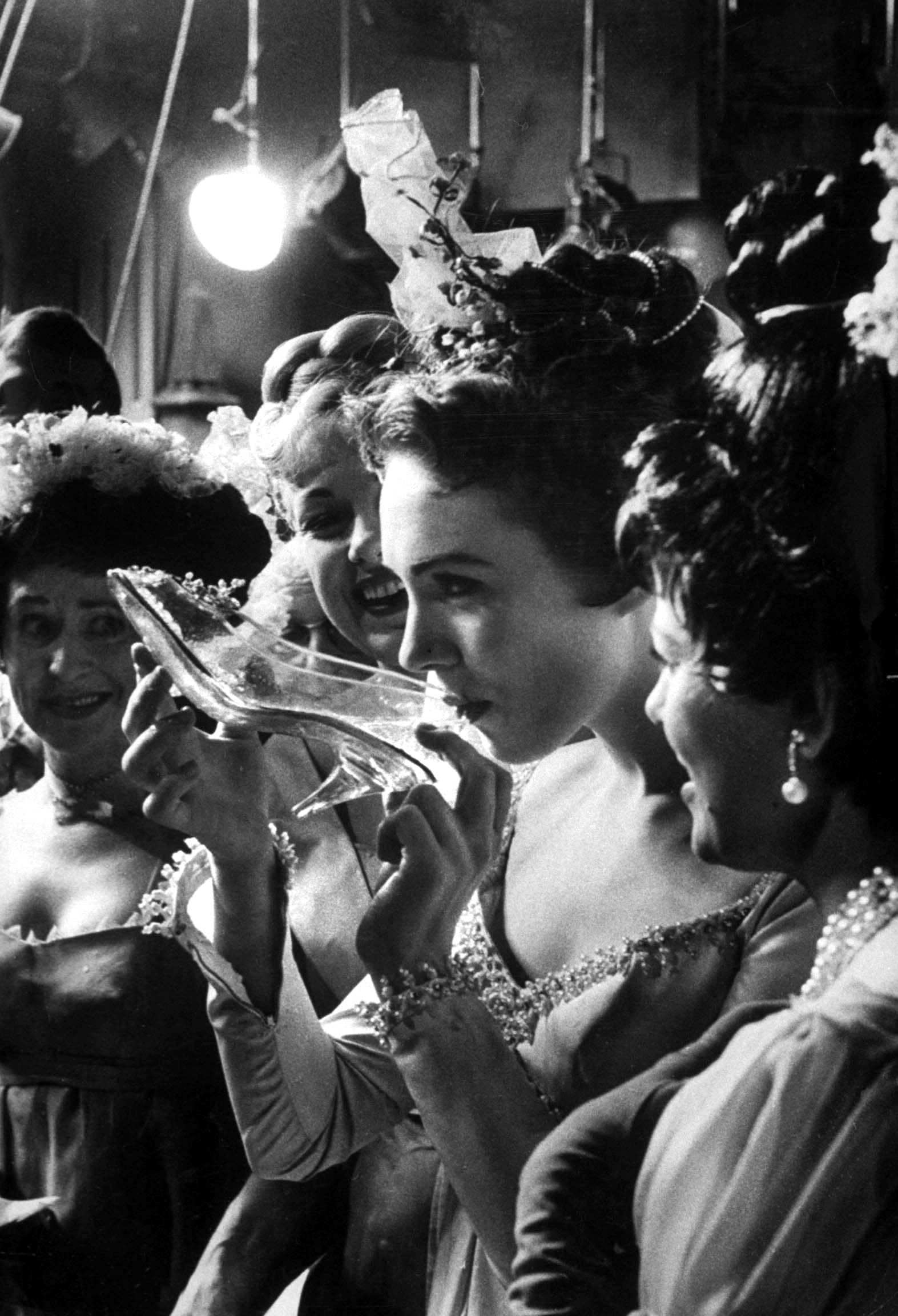 <b>Caption from LIFE.</b> After the show Julie Andrews drinks toast to the rest of the cast from her glass slipper