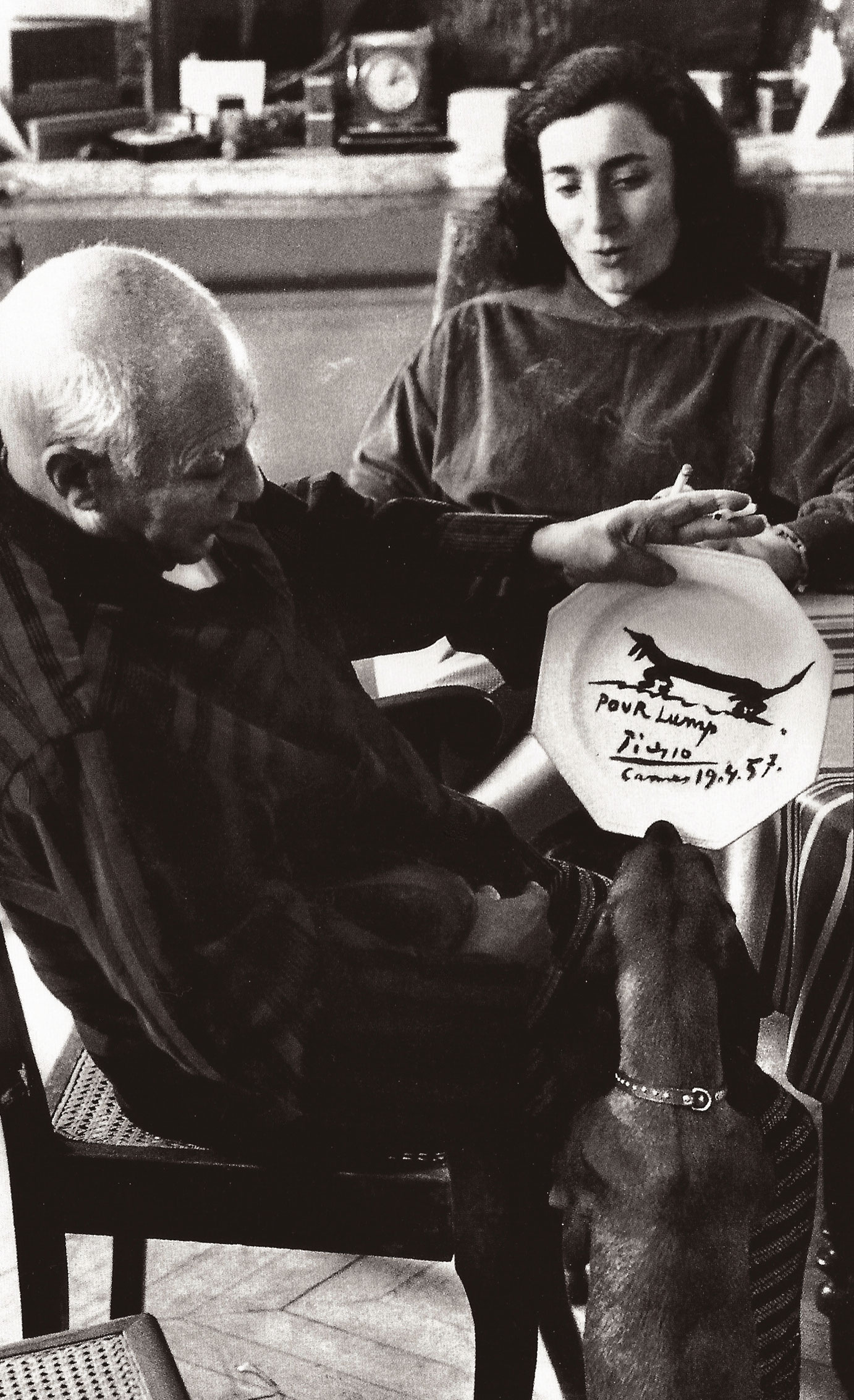 Picasso paints dog Lump a dinner plate.