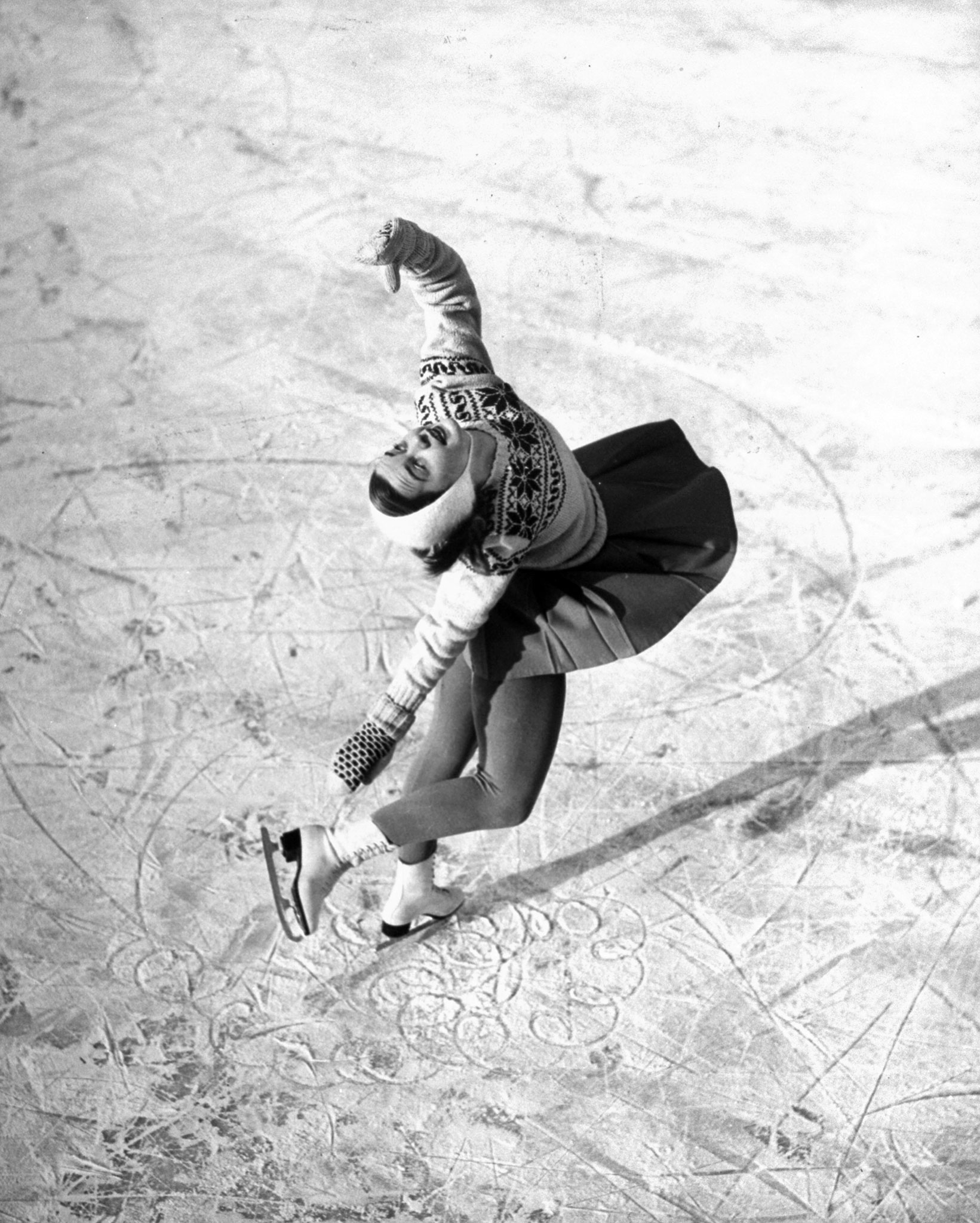 <b>Caption from LIFE.</b> Ice skater Barbara Ann Scott makes her school figures with perfect loops and whorls as she annexes the world championship in Stockholm.