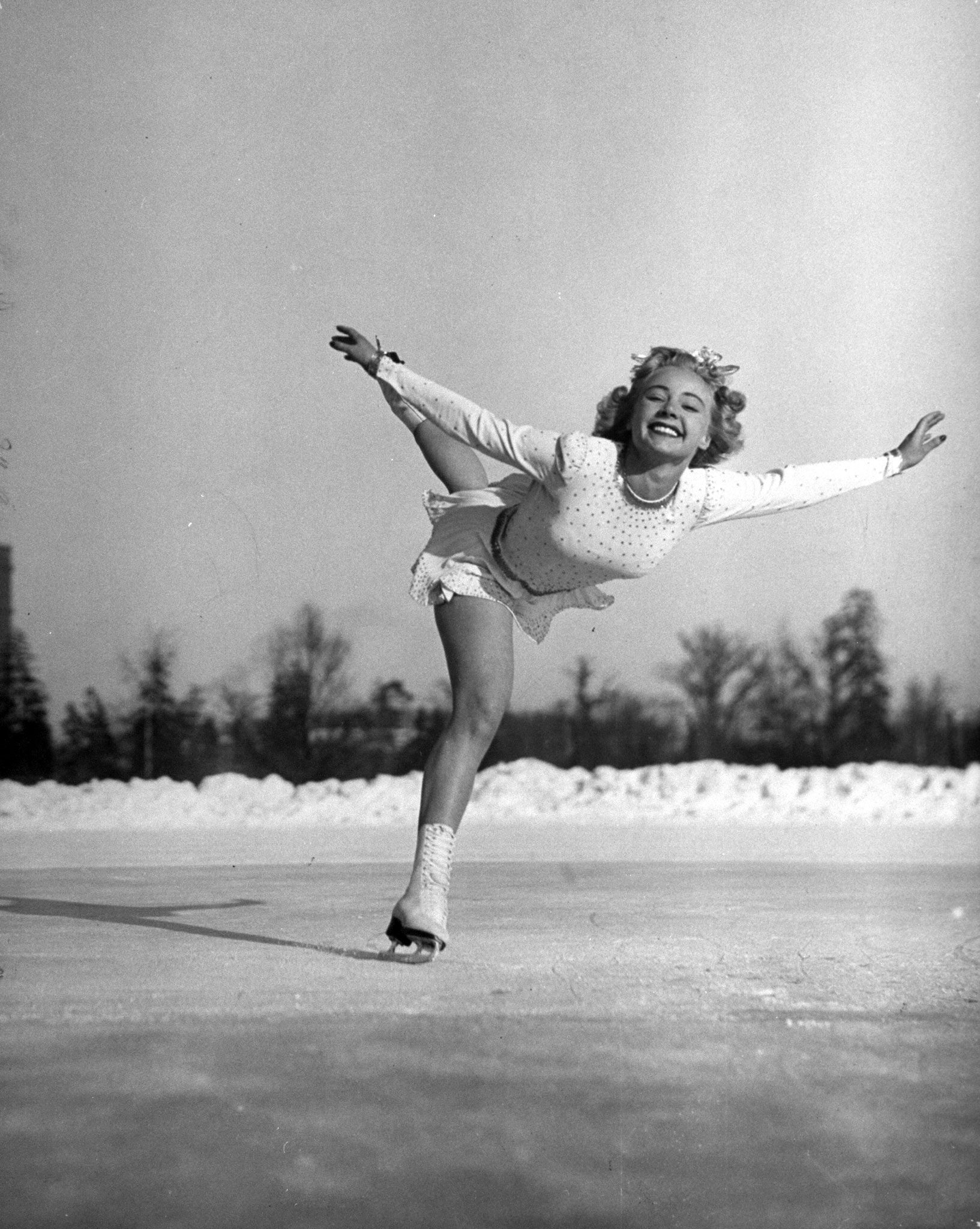 <b>Caption from LIFE.</b> Gretchen Merrill, U.S. champion, was Miss Scott's only serious rival for world title. She spoiled her chances on last day by falling down, won third place.