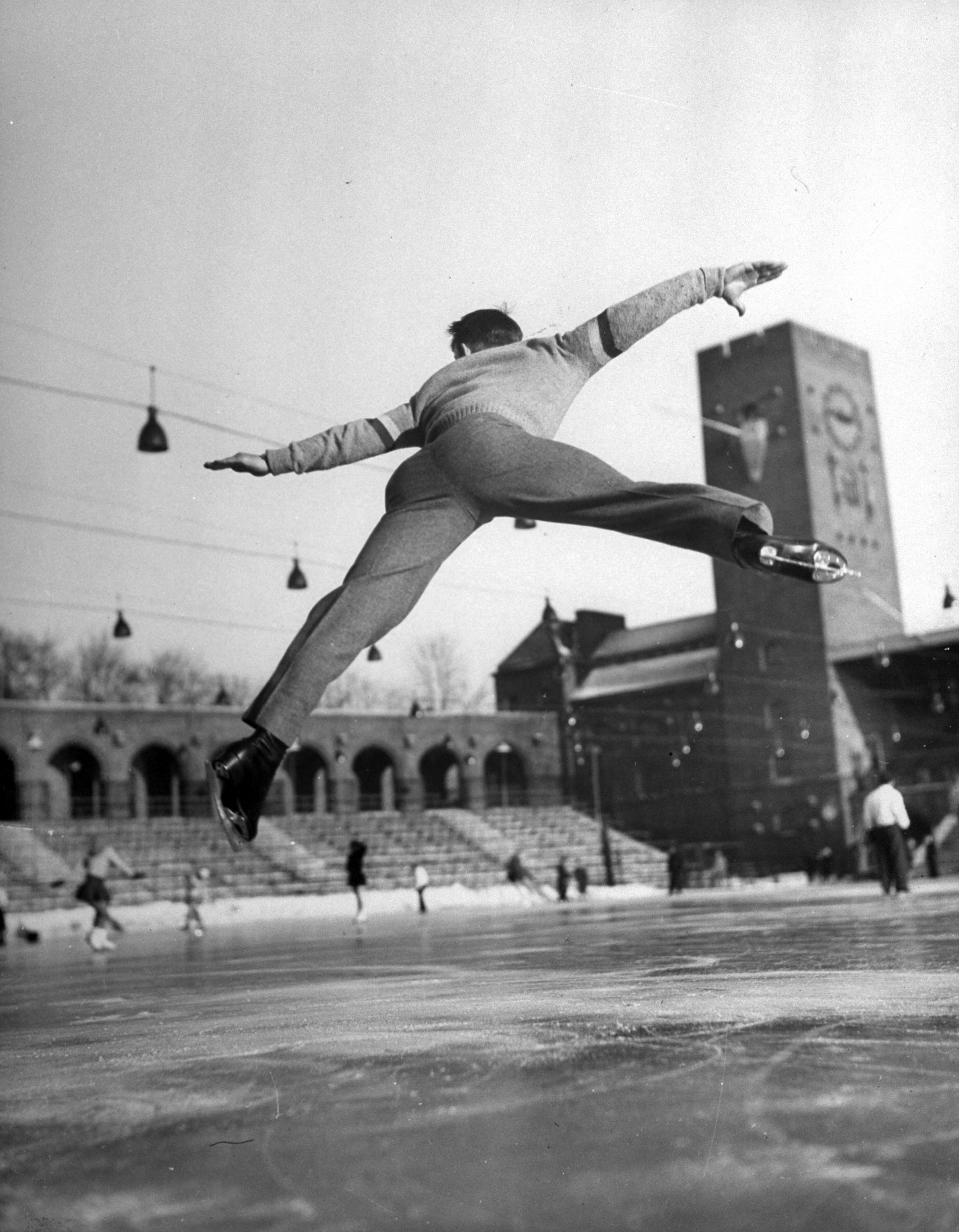 <b>Caption from LIFE.</b> Split jump was part of Button's flashy routine, which thrilled pro-American spectators, but only bewildered judges. Swedish press considered him the best.