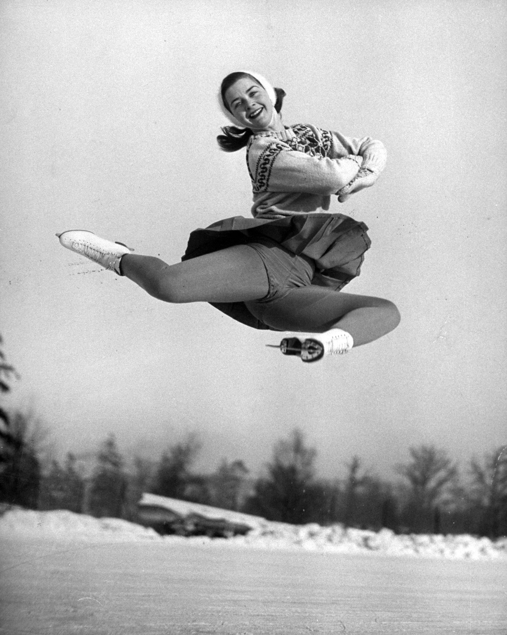 <b>Caption from LIFE.</b> Miss Scott hurtles high into air in a flawless execution of difficult figure called a stag jump.