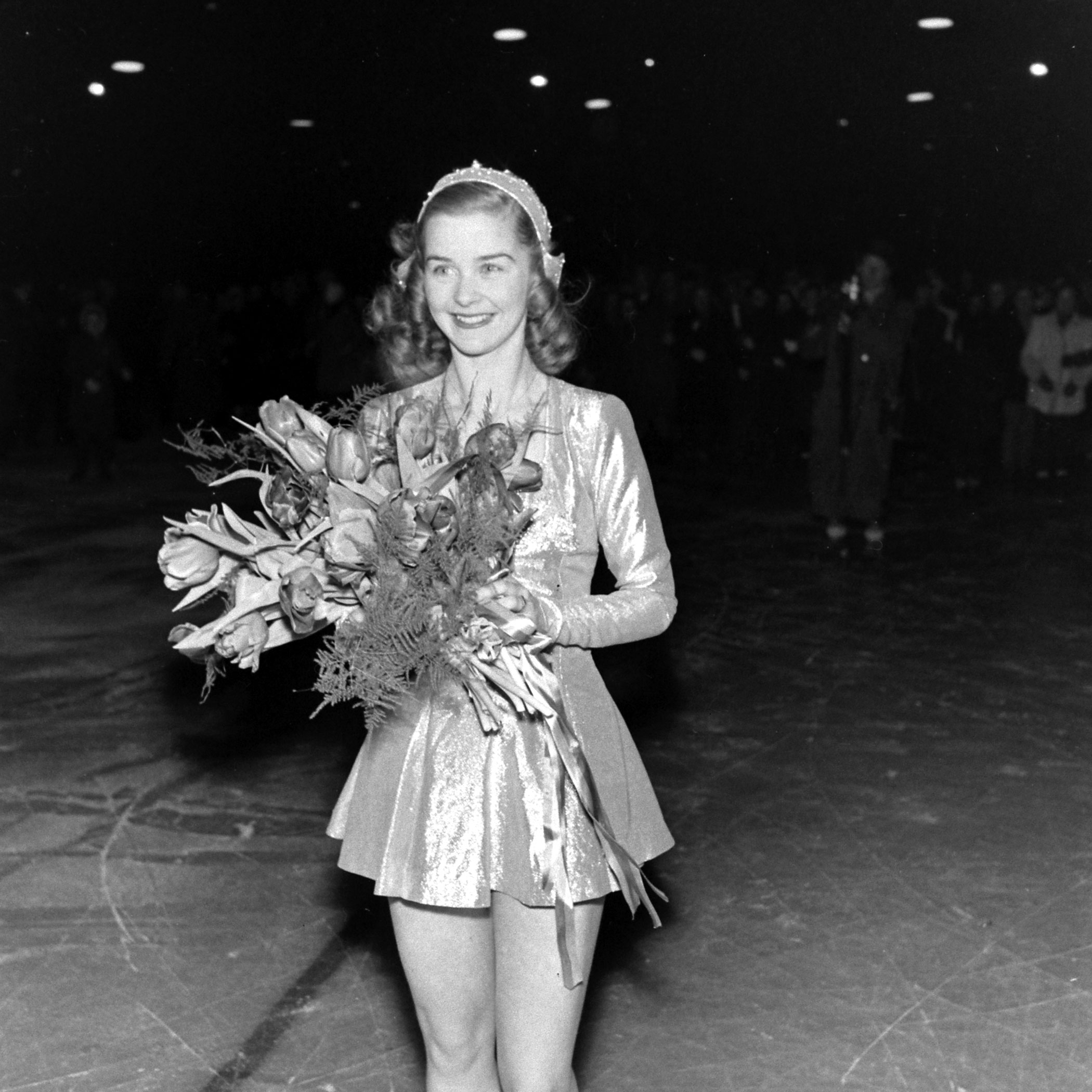 Barbara Ann Scott with flowers at the World Figure Skating Championship in Stockholm, Sweden, 1947.