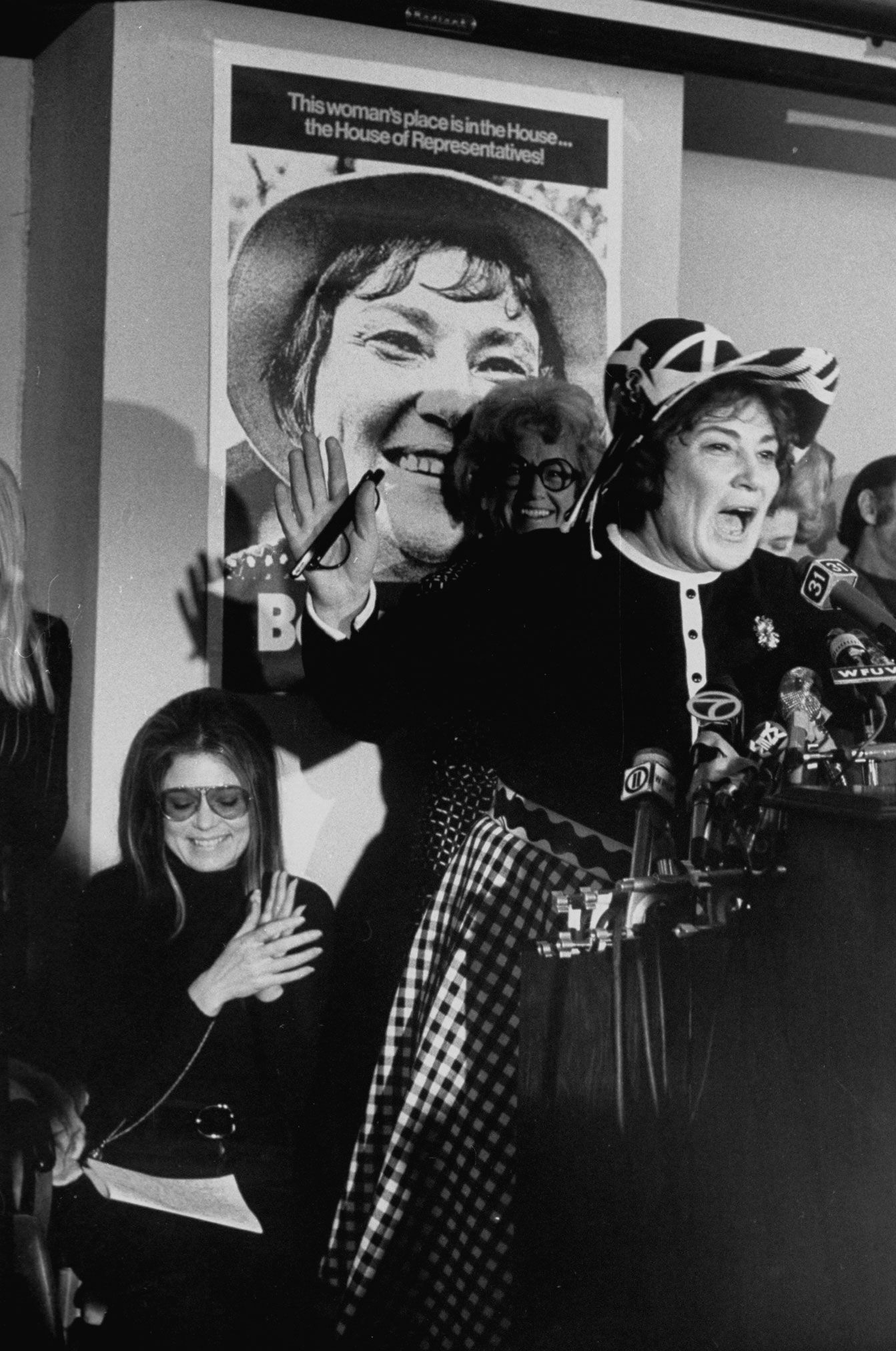 <b>Caption from LIFE.</b> Bella announces her candidacy. Applauding are supporters Gloria Steinem, left, and former Ms. publisher Elizabeth Forsling Harris.