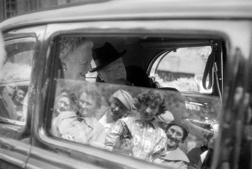 Sir Winston Churchill and his wife Clementine leaving their country home, Chartwell, in Westerham, Kent in 1959.
