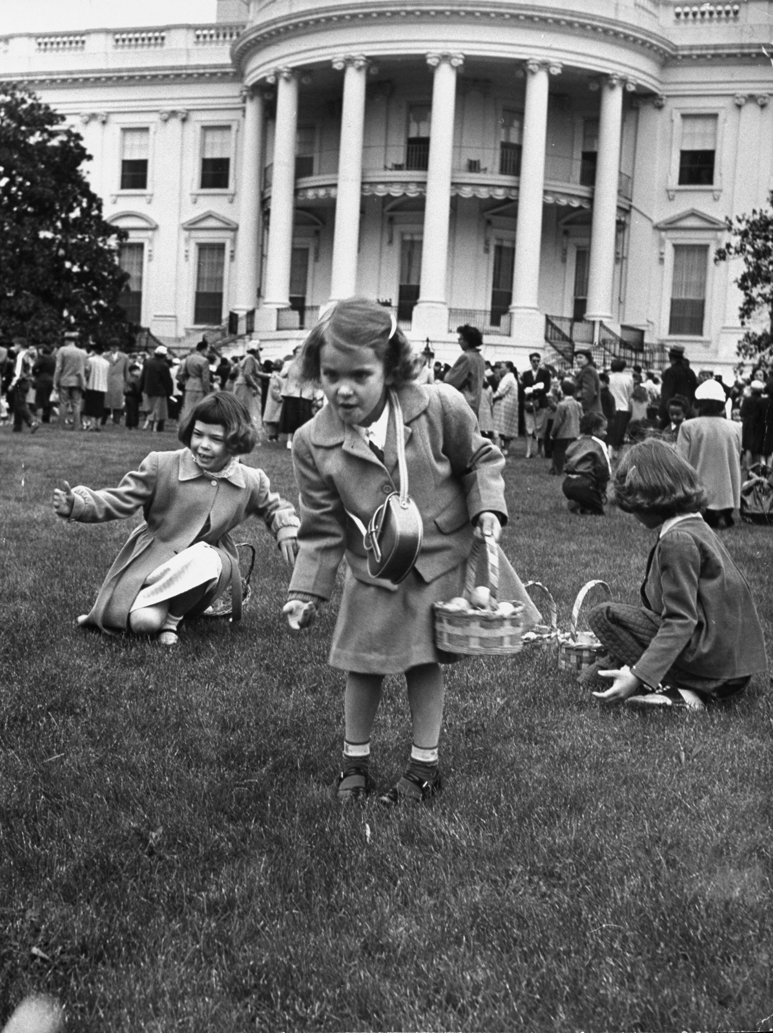 <b>Caption from LIFE.</b> Trio of rollers, more determined than most, juggle eggs away form the crowd. Margaret Mintner (foreground) has just lobbed hers into the lead.