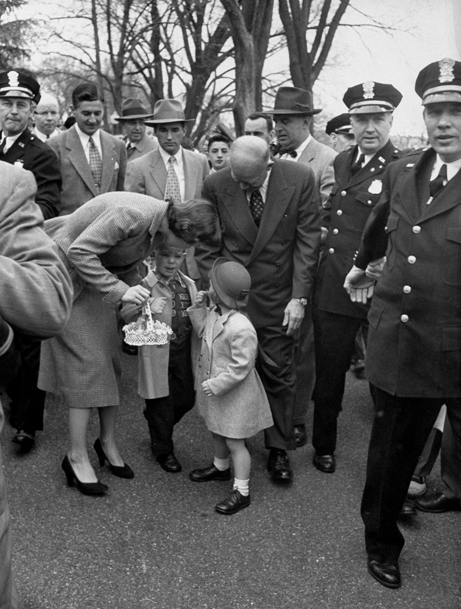 """<b>Caption from LIFE.</b> Almost crying, David tells his mother that his eggs have been lost in the crowd. """"We've got plenty of them,"""" said the President sympathetically."""