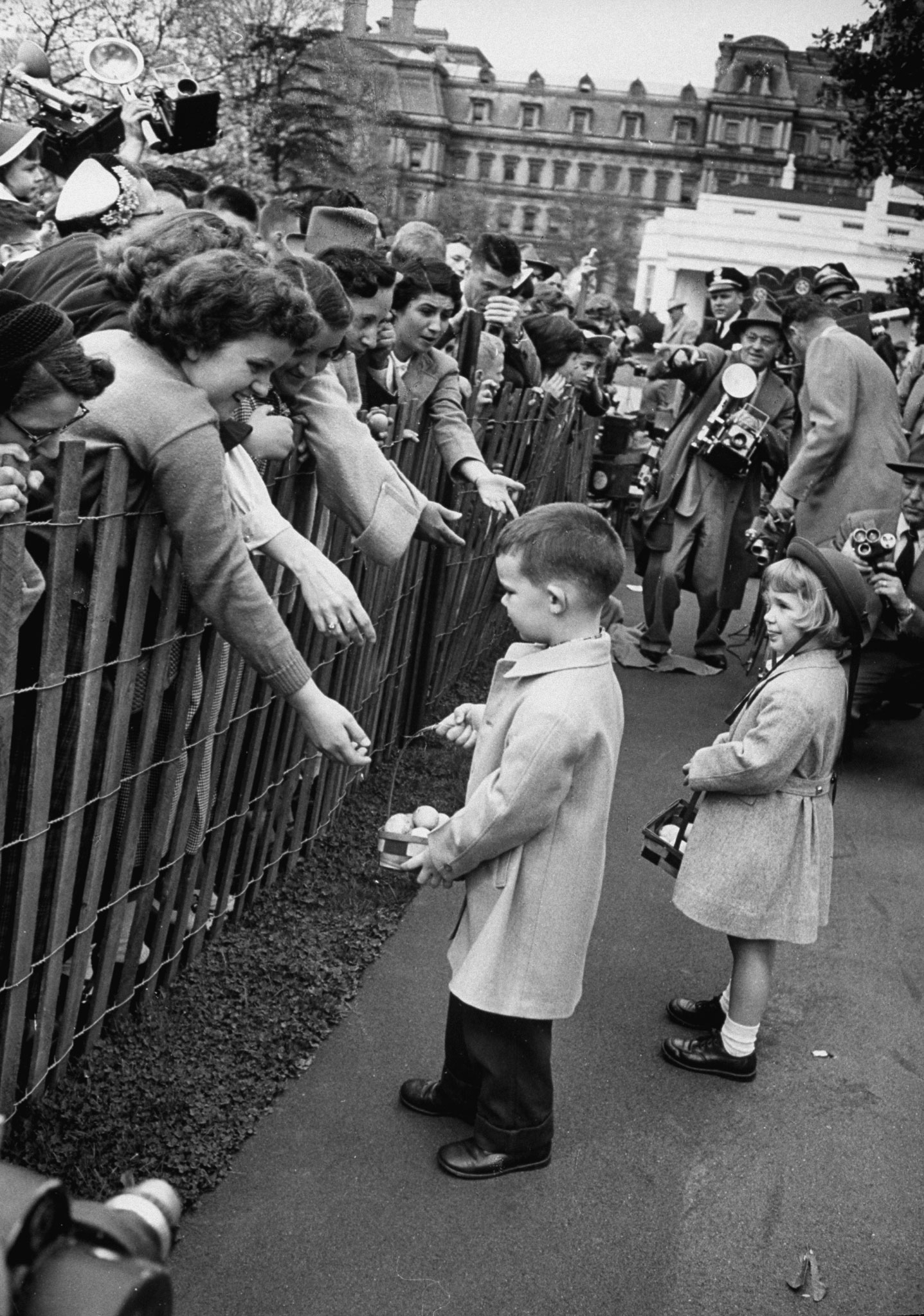 <b>Caption from LIFE.</b> Polite but wary, David dubiously listens to pleas of onlookers who want souvenir eggs. He gave away five, then decided it was high time to stop.
