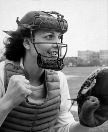 "Catcher May ""Bonnie"" Baker of the South Bend Blue Sox has five brothers, four sisters, all of them catchers on Canadian ball teams. Bonnie once set a grade-school record by throwing a ball 345 feet. She also rides, swims and bowls."