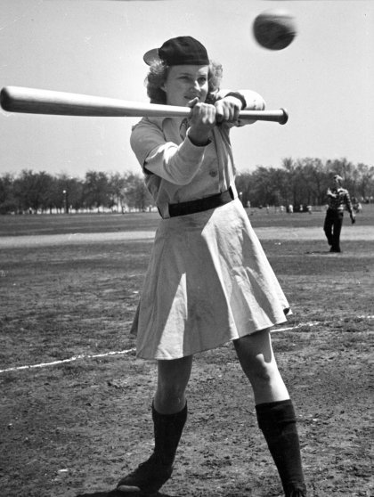 Outfielder Faye Dancer, Fort Wayne, is a heavy hitter. By league rule, skirts must be within six inches of the kneecap.