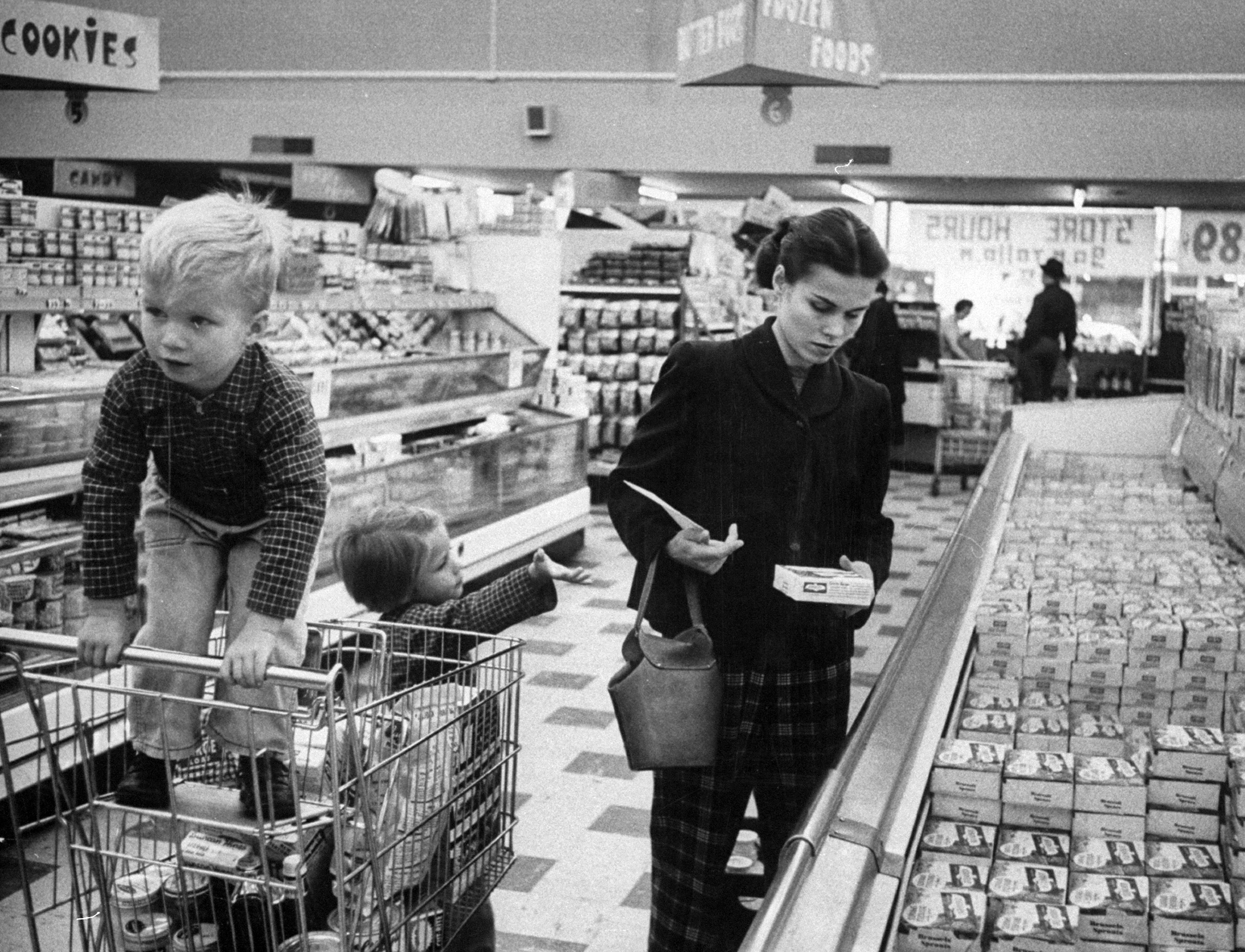 Working mother Jennie Magill shopping with her children at the super market.
