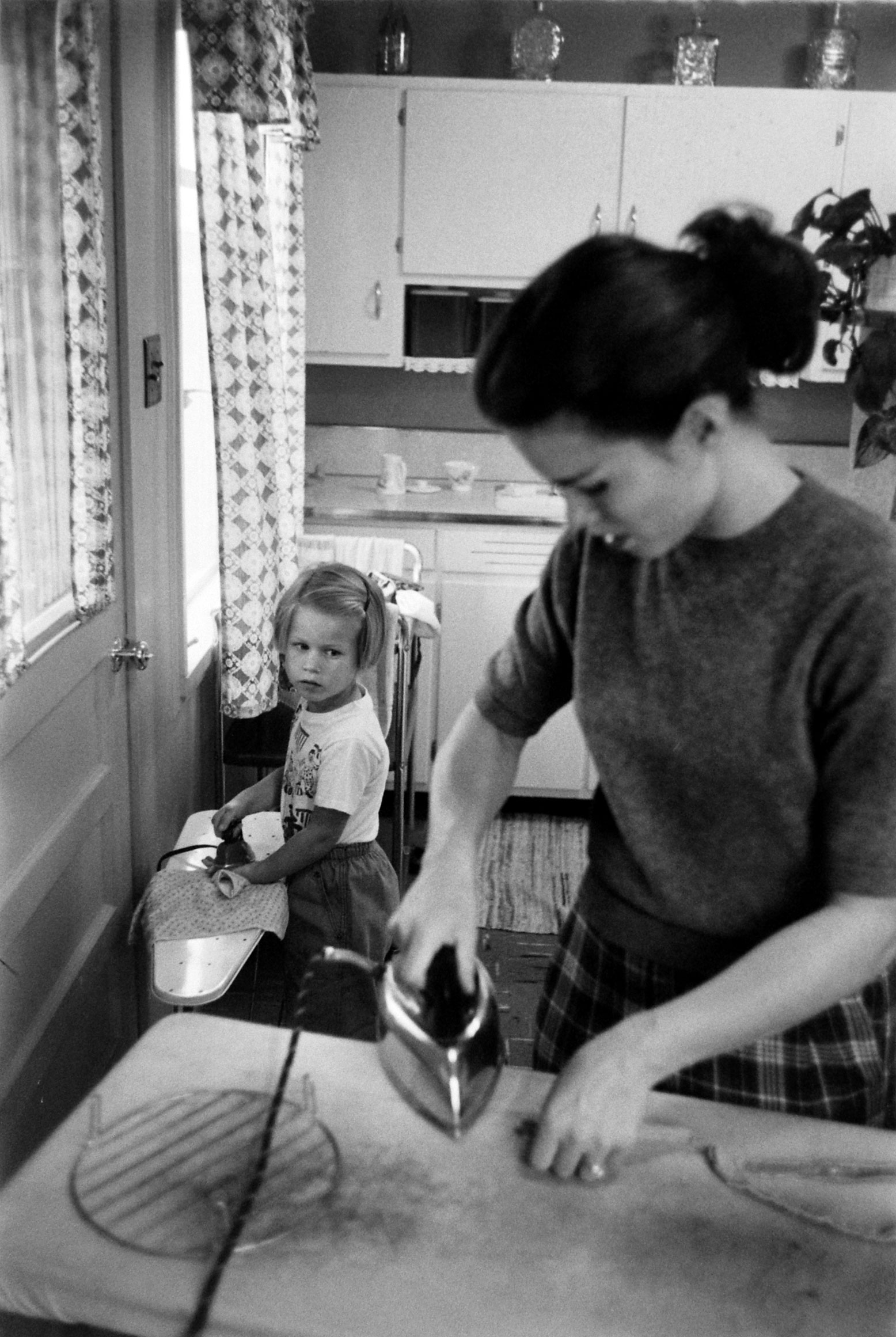 Jennie Magill ironing with her daughter.
