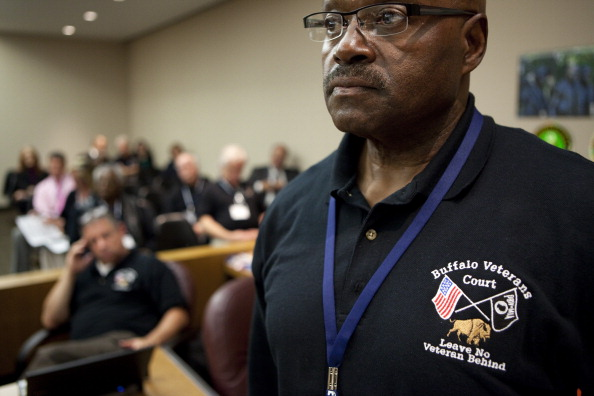BUFFALO, NY - OCTOBER 23: Mentor and veteran Archie Amos waits in court to be assigned to a vet needing help, on October 23, 2012 in Buffalo, New York. The Buffalo Veterans Treatment Court started in January 2008 as a hybrid drug and mental health treatment court to provide judicially monitored treatment to war veterans in the criminal justice system. Vets appearing here struggle with substance addiction or serious mental health disease often accompanied by PTSD. The court provides lots of support to vets to keep them out of trouble. (Photo by Melanie Stetson Freeman/The Christian Science Monitor via Getty Images)