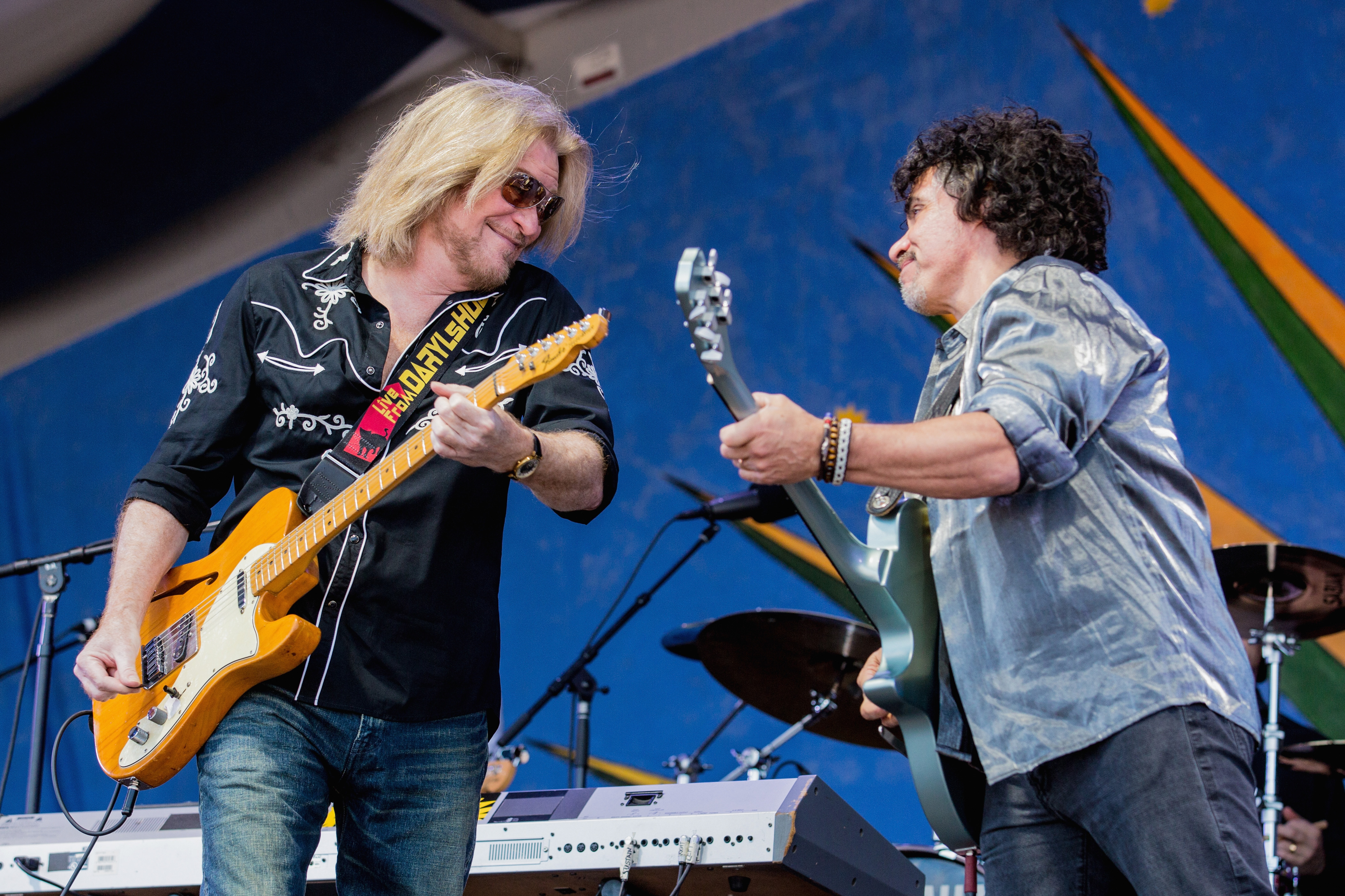 (L-R) Daryl Hall and John Oates of Haul and Oates performs during the 2013 New Orleans Jazz & Heritage Music Festival at Fair Grounds Race Course on May 5, 2013 in New Orleans, Louisiana.