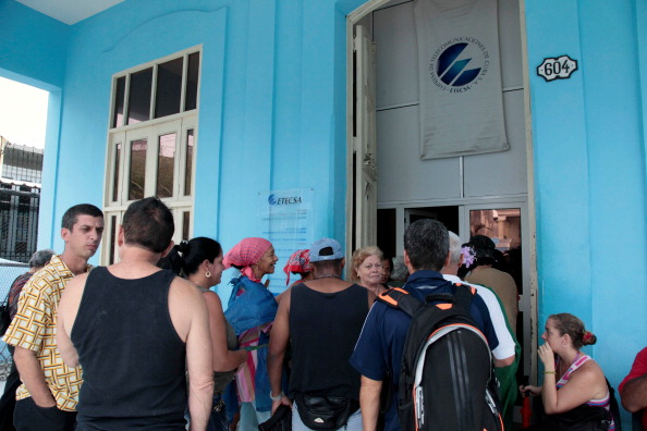Cubans line up at a cyber place in Havana on June 4, 2013. The government opened today 118 places with full internet access in 334 computers with a cost of 4,50 dollars per hour. This is the first time that Cubans have full access to internet.   AFP PHOTO/str        (Photo credit should read STR/AFP/Getty Images)
