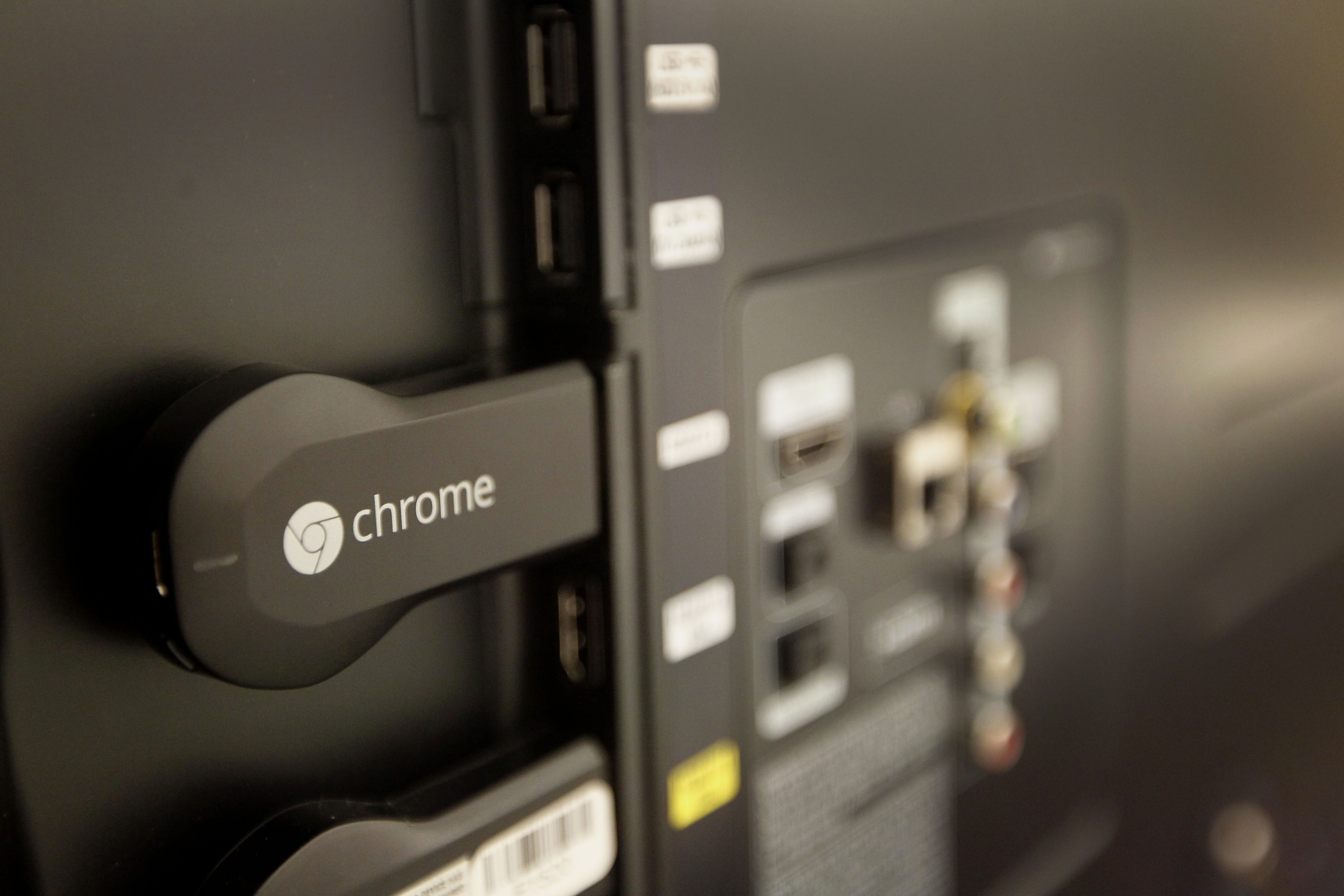 The new Google Chromecast is connected to the the back of a television during an event in San Francisco, California, U.S., on Wednesday, July 24, 2013.