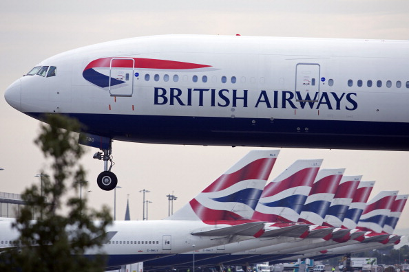 A British Airways aircraft prepares to land at Heathrow airport in London on Sept. 30, 2013.