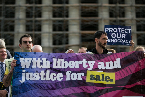 WASHINGTON, DC - OCTOBER 8:  Activists hold up a banner during a rally against money in politics, at the Supreme Court in Washington, on October 8, 2013 in Washington, DC. On Tuesday, the Supreme Court heard oral arguments in McCutcheon v. Federal Election Committee, a first amendment case that will determine how much money an individual can contribute directly to political campaigns. (Photo by Drew Angerer/Getty Images)