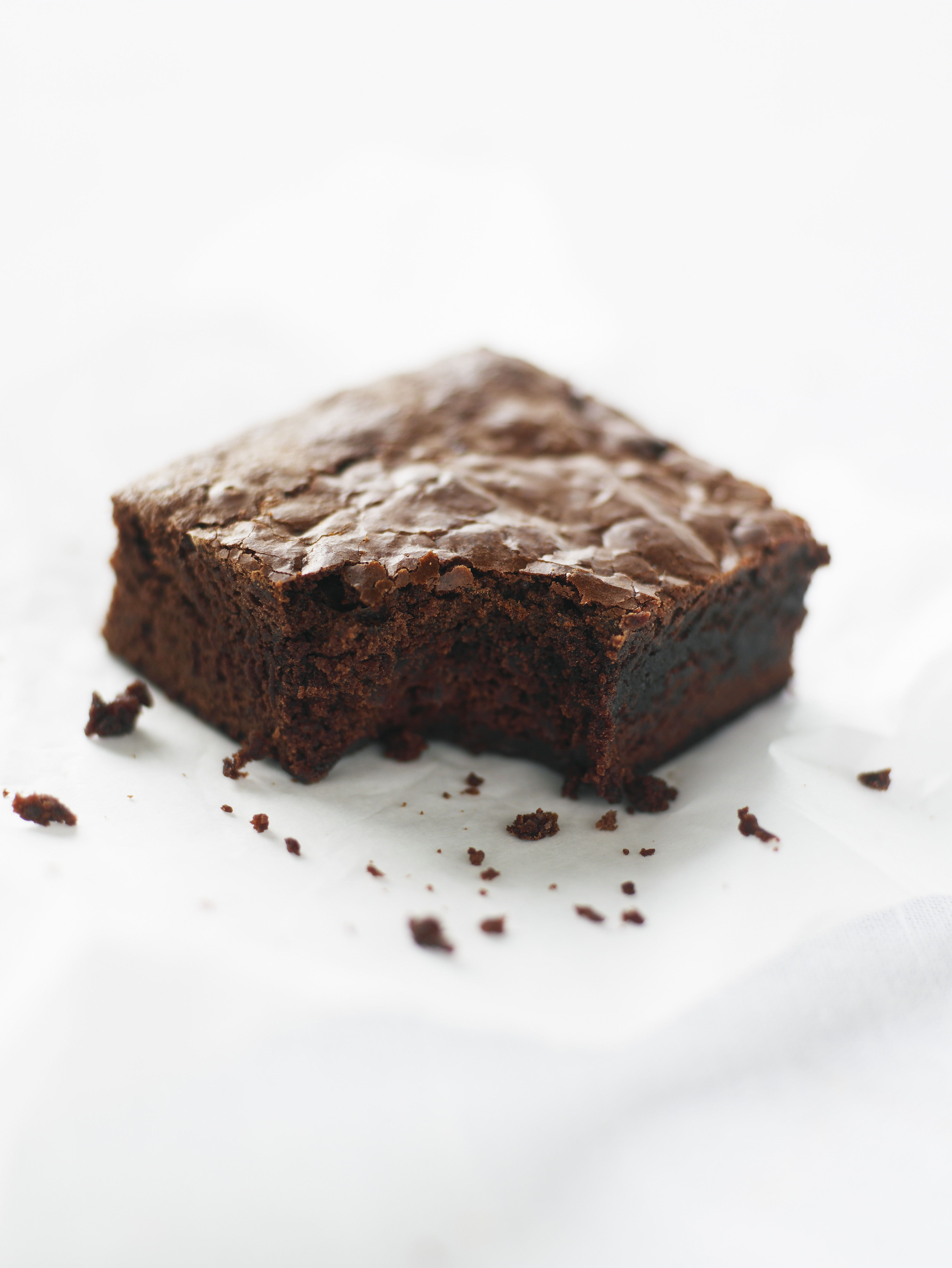 Double-chocolate brownie missing one bite