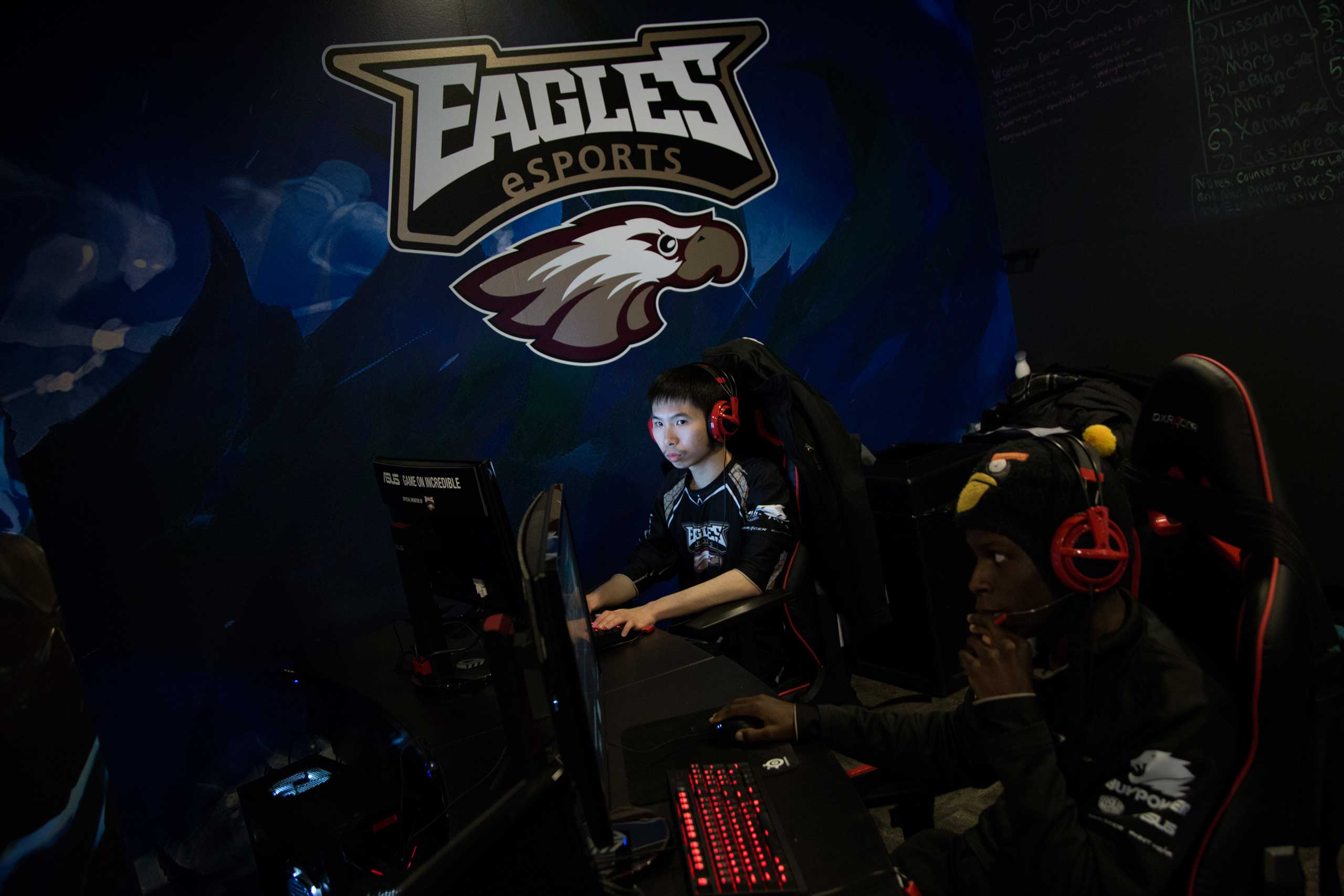 "Chris ""STARS FourEyes"" Broadnax (right), 21 and Mario ""ThirstDrinker"" Huang, 26, practice <i>League of Legends</i> and other video games in Robert Morris University's video game practice space in Chicago, March 18, 2015."