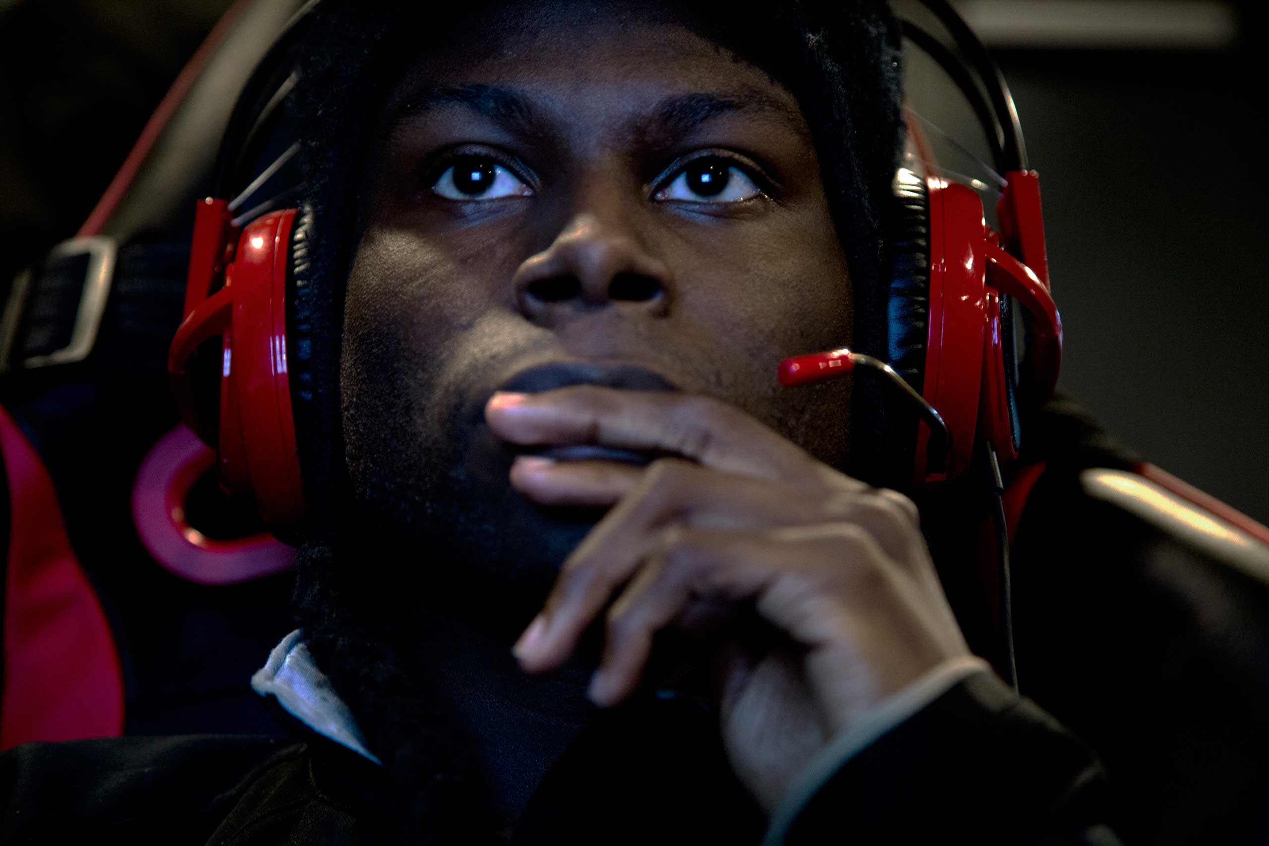 "Chris ""STARS FourEyes"" Broadnax, 21, a graphic design major, plays video games in Robert Morris University's video game practice space in Chicago, March 18, 2015."
