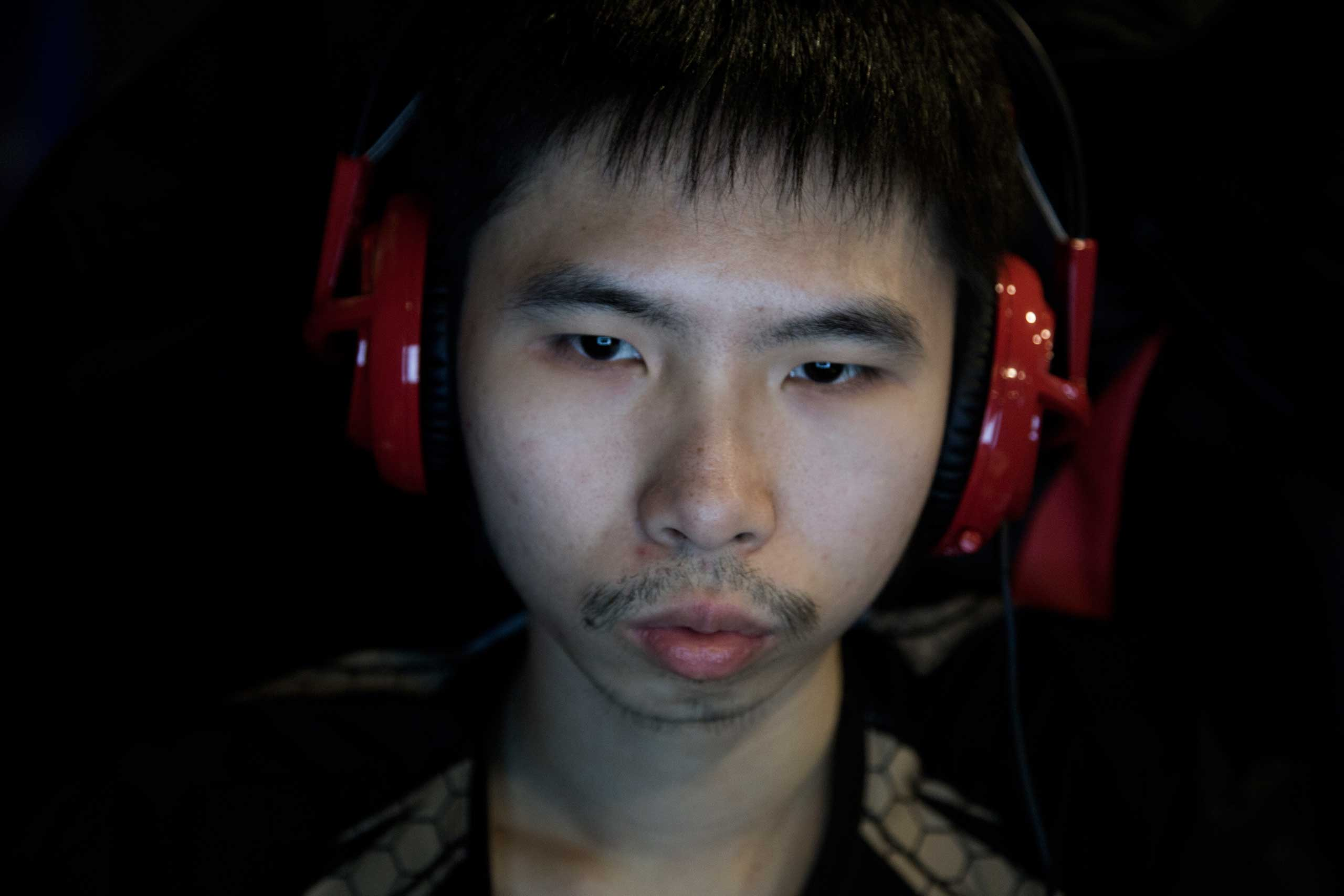 "Mario ""ThirstDrinker"" Huang, 26, a sophomore studying Drafting Technology, practices <i>League of Legends</i> and other video games in Robert Morris University's video game practice space in Chicago, March 18, 2015."