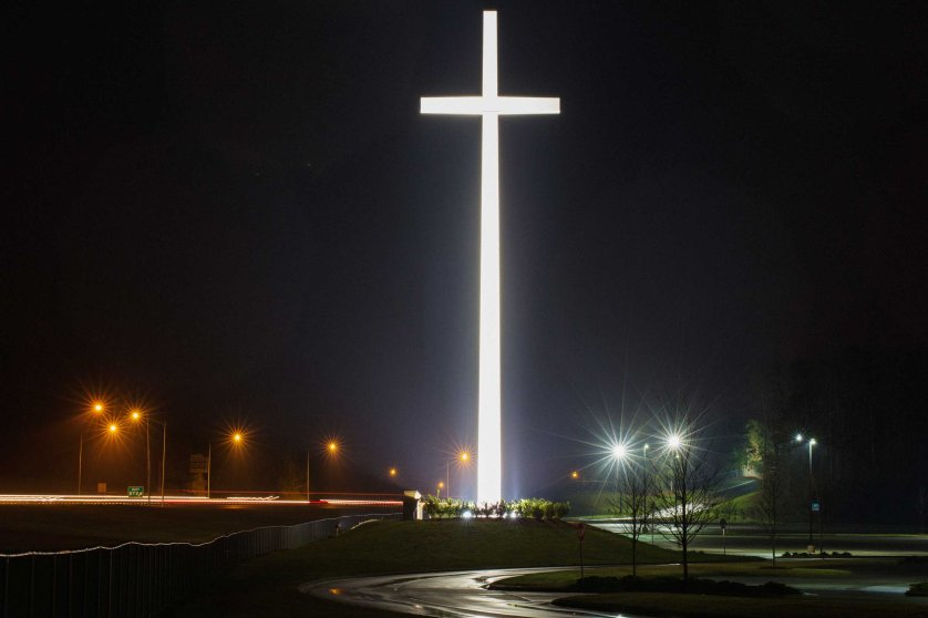 A giant cross by highway I-65 is illuminated at night, marking the site of Gardendale First Baptist Church in Gardendale, Ala. on March 21, 2015.